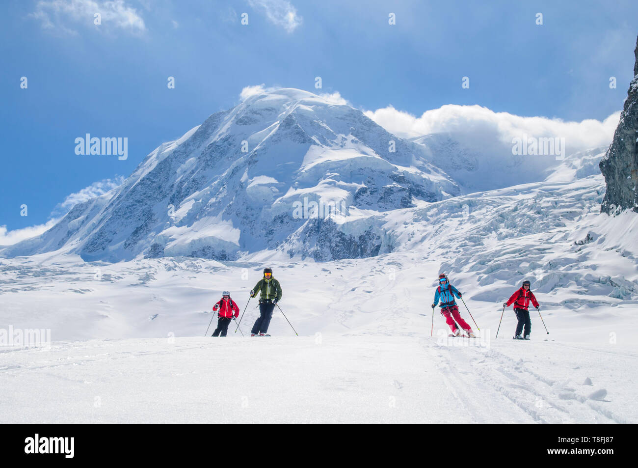 Freeriders skiing in front of the impressive Monte Rosa Stock Photo