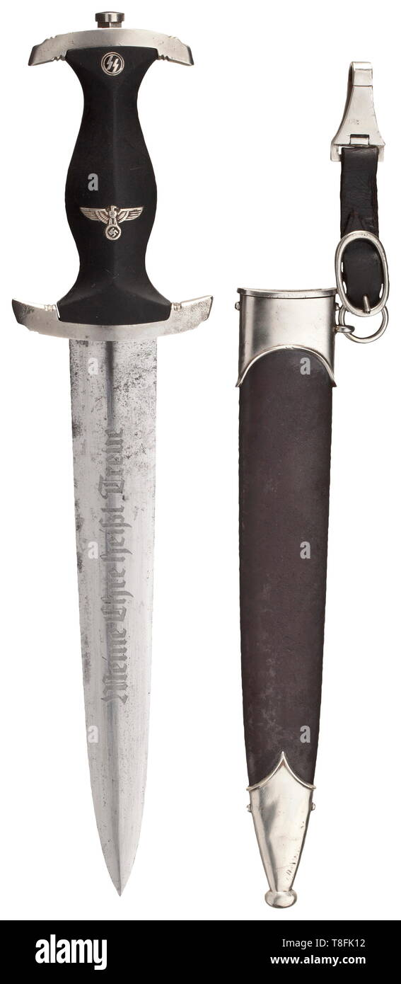 "A SS honour dagger M 34 with removed dedication The blade etched on the obverse side with the motto ""Meine Ehre heißt Treue""(My Honour is Loyalty), and on the reverse with the ""Carl Eickhorn Solingen"" and signs of the removed dedication. Black wooden grip with inlaid emblems. The nickel-silver crossguard marked ""I"" on the side. Rust-coated iron scabbard with remnants of the black finish and nickel-silver mounts. Leather hanger. Traces of age and usage. Length ca. 37 cm. Rare dagger. historic, historical, 20th century, 1930s, 1940s, Waffen-SS, armed division of the SS, armed, Editorial-Use-Only Stock Photo"