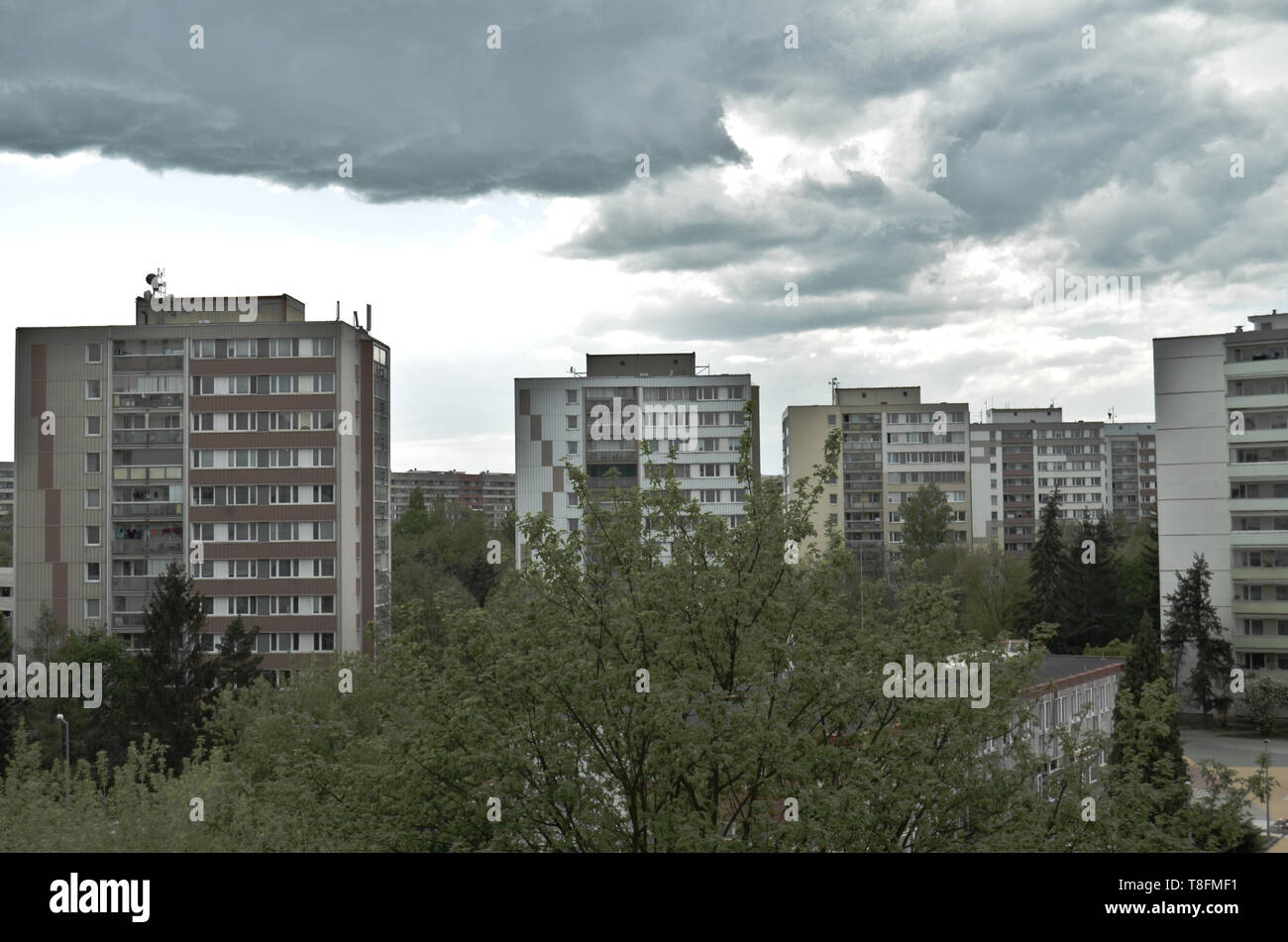 Depressing view of ugly communist building blocks (panelak) on a cloudy day at Prague on an average concrete buildings estate - Stock Image