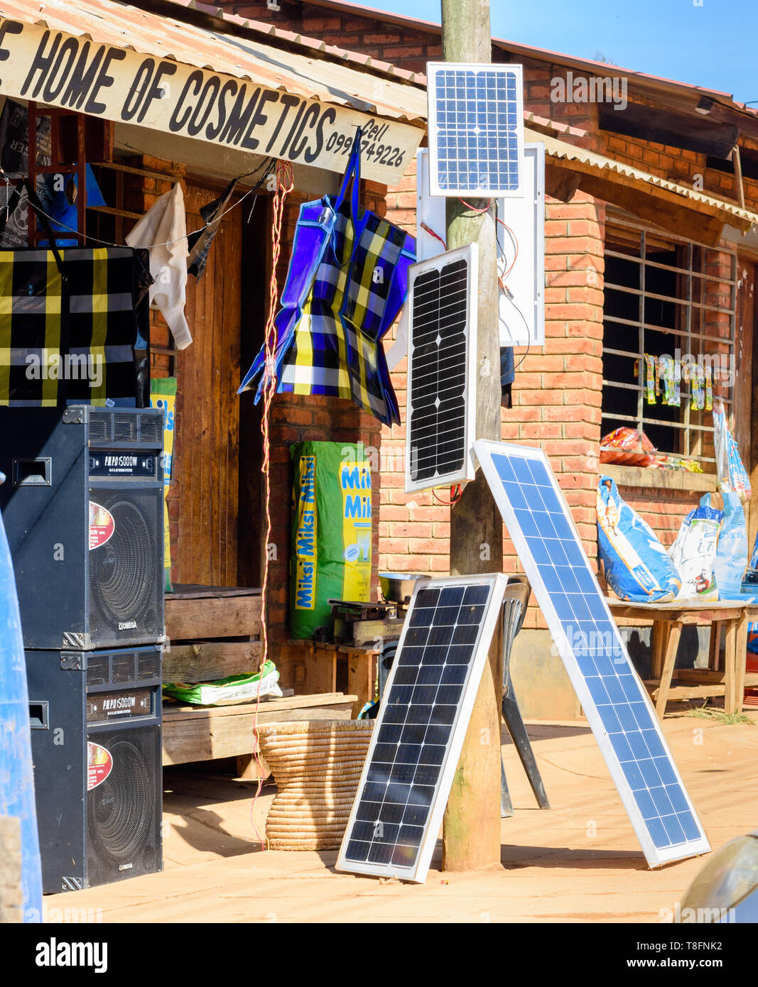 solar panels and speakers for sale at a retail shop in Dedza Market Malawi - Stock Image