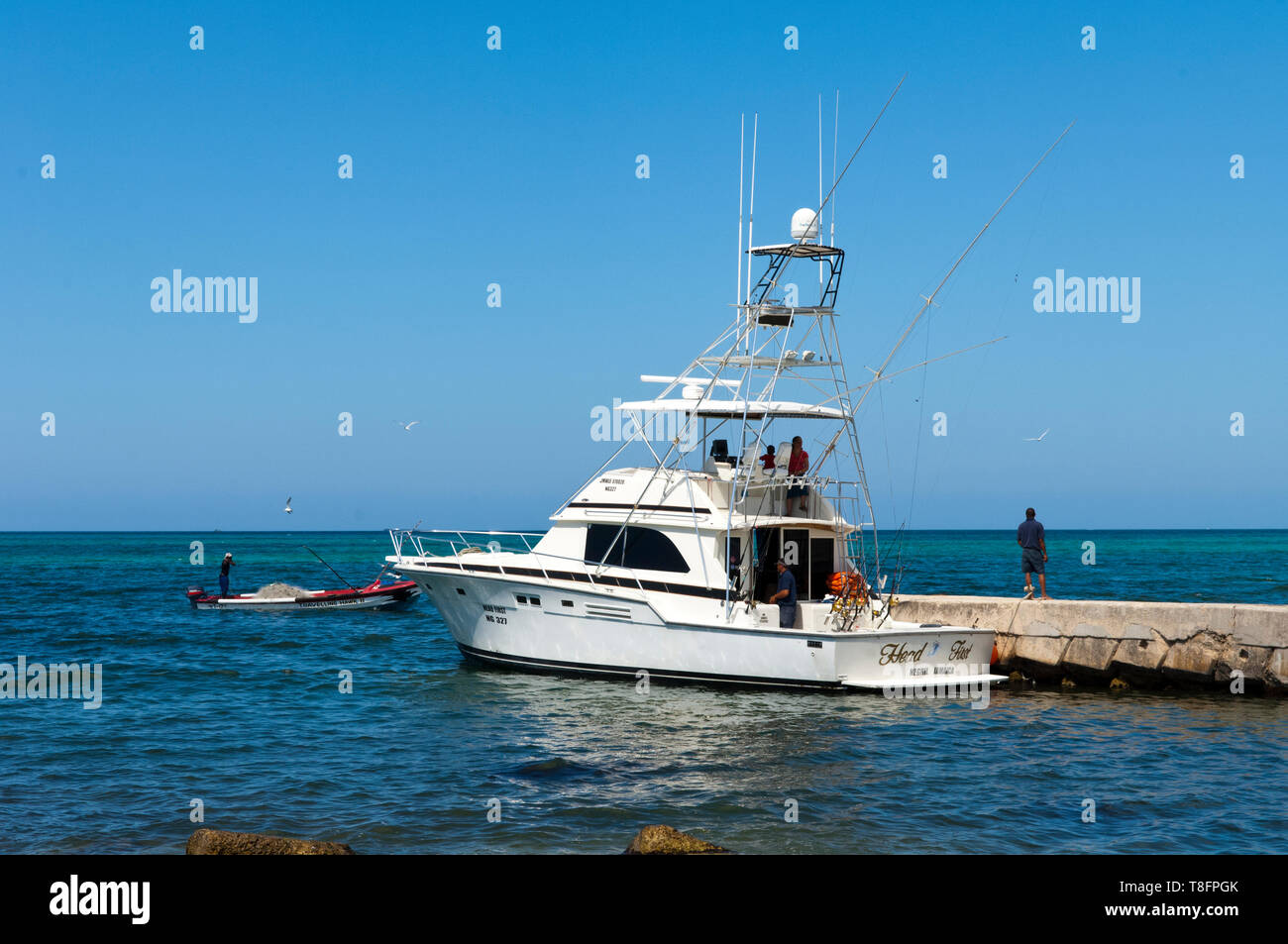 Deep Sea Fishing Boat At The Pier In Negril Stock Photo