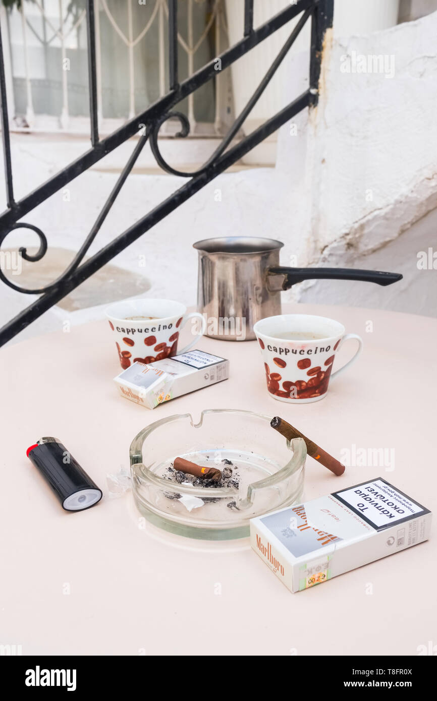 4bd71d9ba15 Still life photo with greek coffee and cigarettes on the table in Greece -  Stock Image