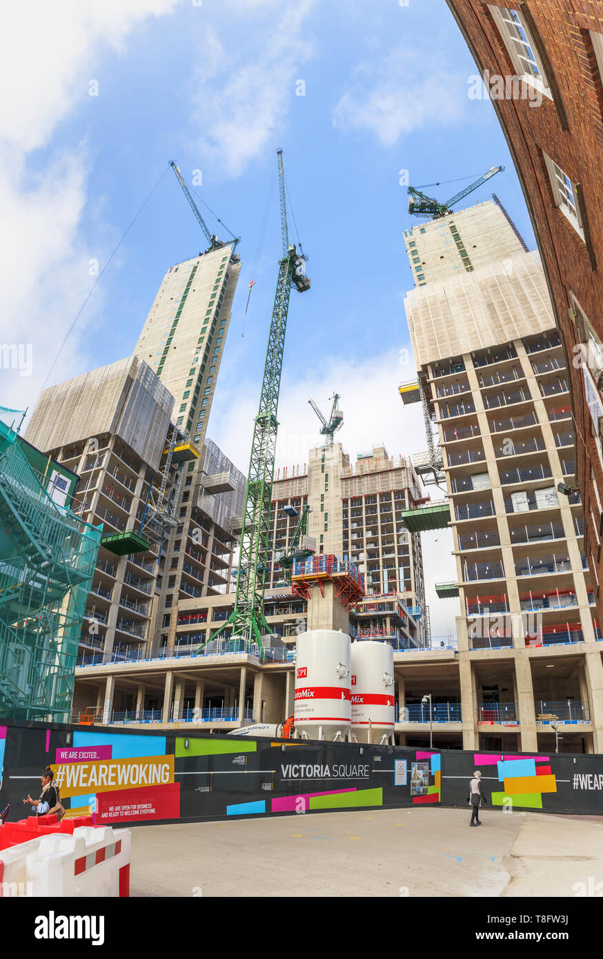 Woking, Surrey: construction of the new high rise mixed use Victoria Square development continues with concrete cores and tower cranes Stock Photo