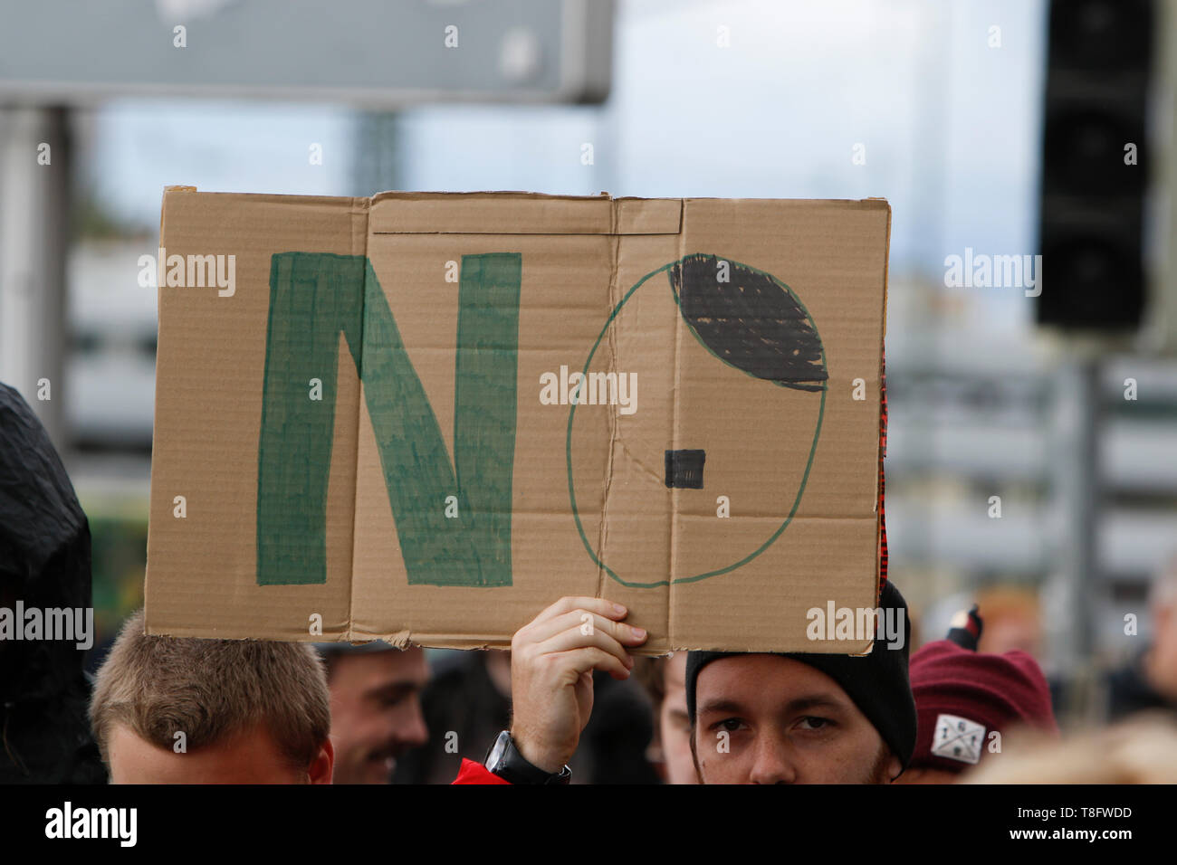 Pforzheim, Germany. 11th May, 2019. A protester holds a sign that reads 'No'. The O looks like a stylised Hitler. Around 80 people participated in a march through Pforzheim, organised by the right-wing party 'Die Rechte' (The Right). The main issues of the march was the promotion of voting for Die Rechte' in the upcoming European Election and their anti-immigration policies. They were confronted by several hundred counter-protesters from different political organisations. Credit: Michael Debets/Pacific Press/Alamy Live News - Stock Image