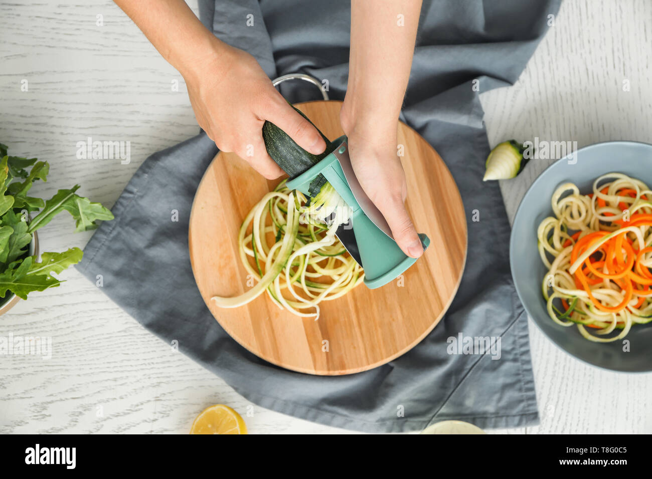 Woman making zucchini spaghetti Stock Photo