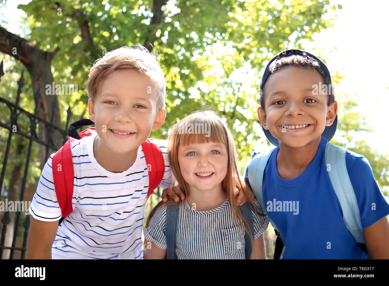 Cute little schoolchildren outdoors - Stock Image