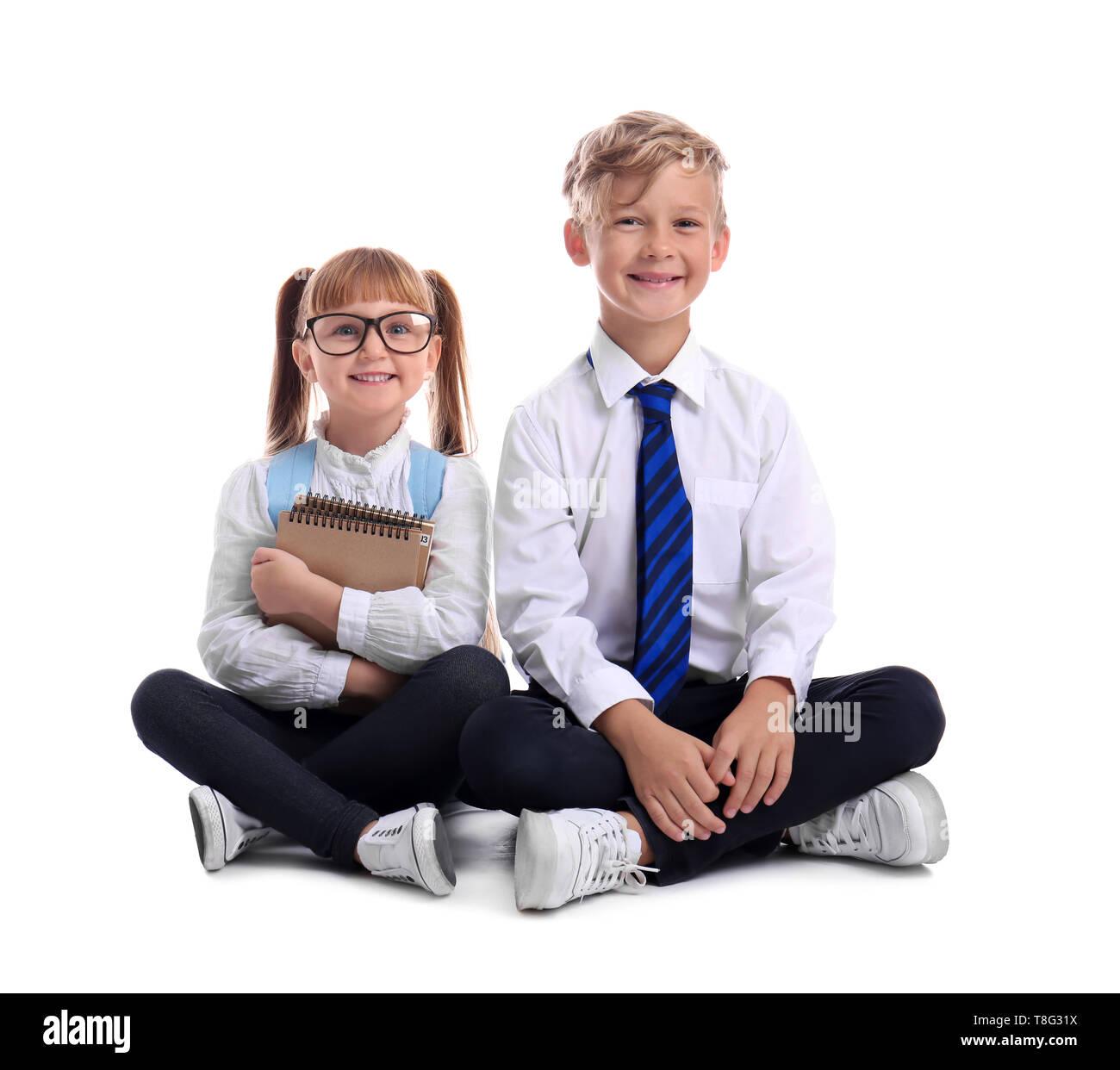 Cute little schoolchildren on white background - Stock Image