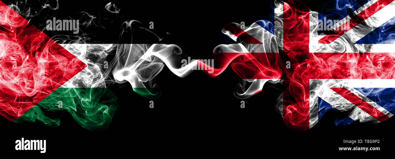 Palestine vs United Kingdom, British smoky mystic flags placed side by side. Thick colored silky smokes flag of Palestinians and United Kingdom, Briti - Stock Image