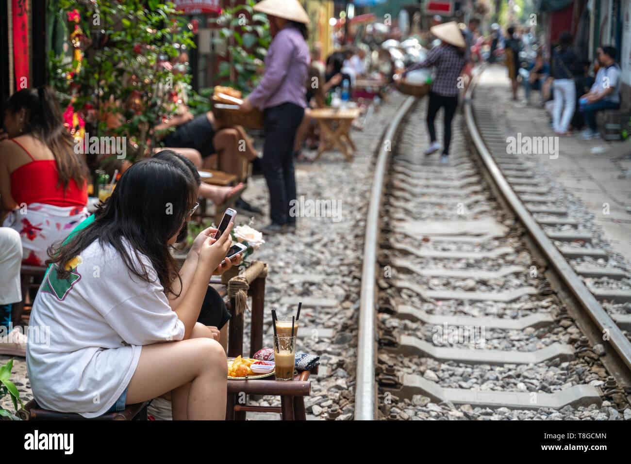Railway Cafe People Drink Coffee Or Walking On Railways Waiting For Train To Arrive On Railway Road In Hanoi Vietnam Stock Photo Alamy