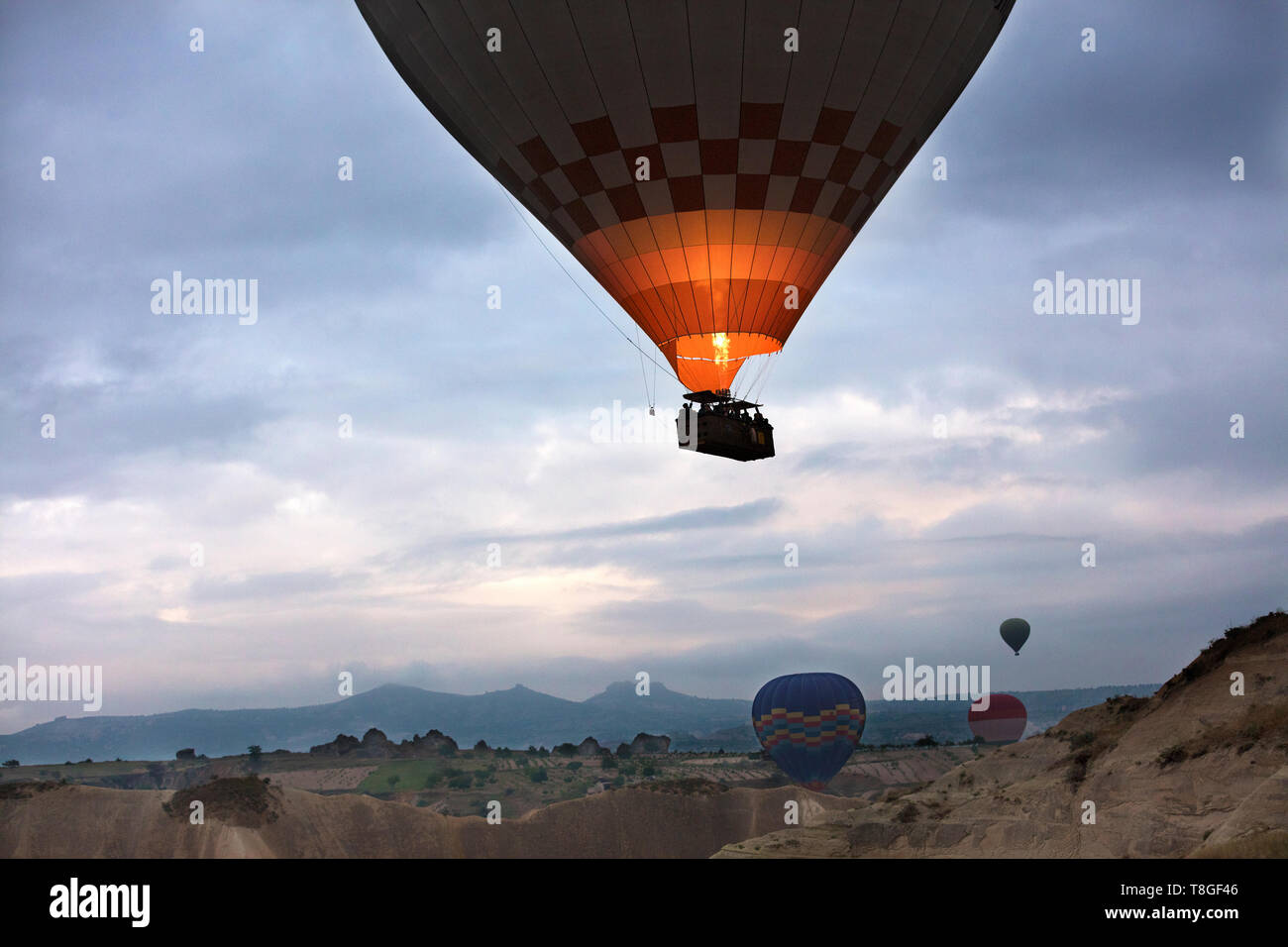 A view of the colored balloon flying over the Valley at dawn. Cappadocia. 12.05.2018. Turkey. - Stock Image