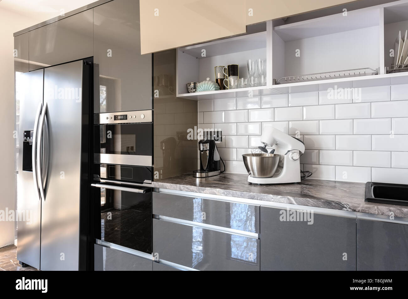 Spacious Luxury Well Designed Modern Grey Beige And White Kitchen Door Of Electric Oven Are Open Stock Photo Alamy