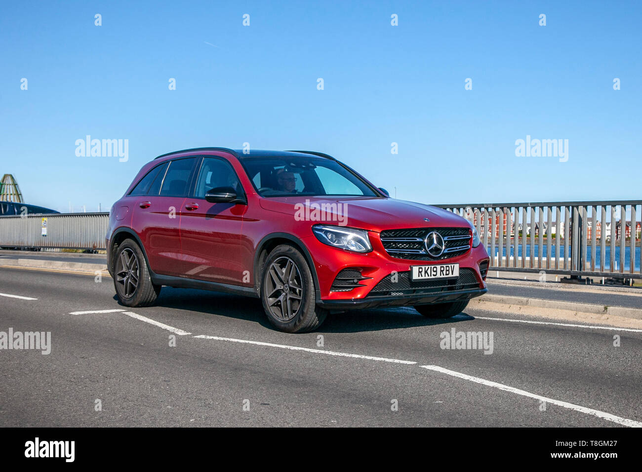 Red 2019 Mercedes-Benz GLC 250 AMG Night Edition on the seafront promenade, Southport, Merseyside, UK - Stock Image