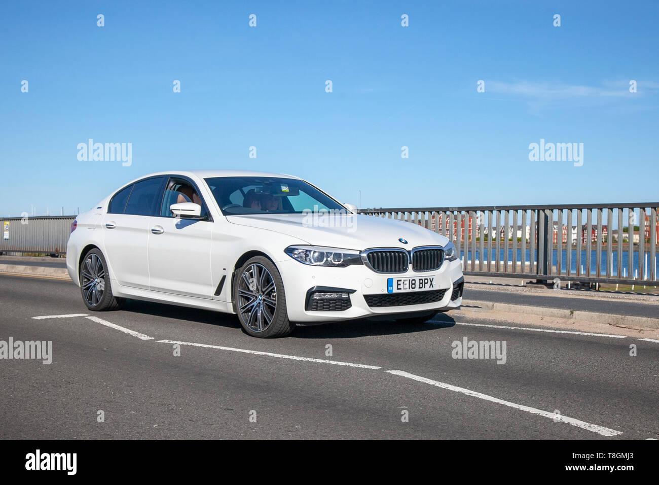 White 2018 BMW 530E M Sport Auto  on the seafront promenade, Southport, Merseyside, UK - Stock Image