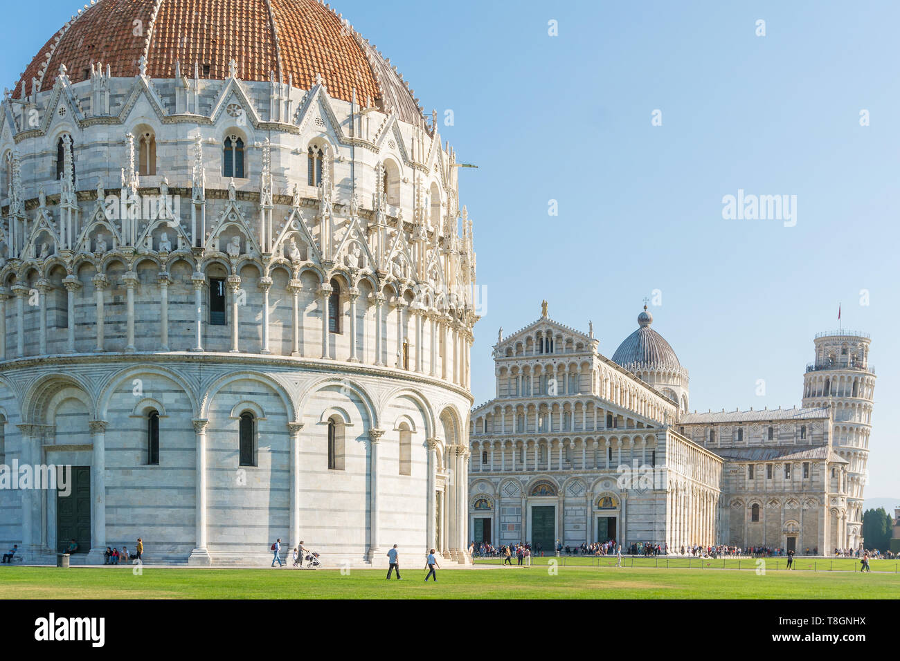 Pisa, Italy-October 21, 2018:tourists walk among the symbolic places of Pisa admiring the beauty and taking pictures during a sunny day - Stock Image