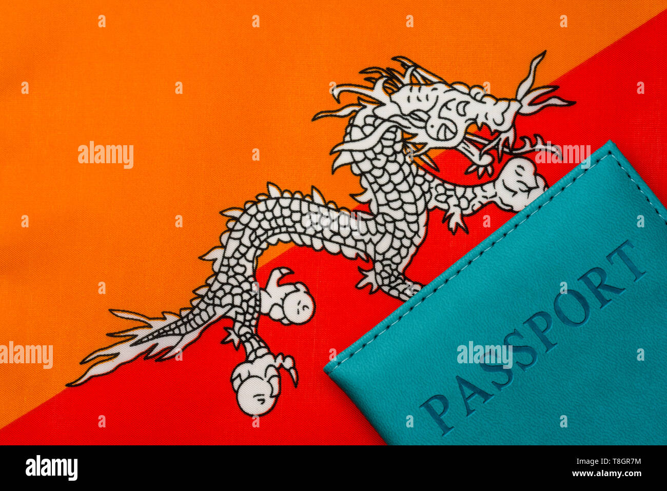 Against the flag of Bhutan is a passport. The concept of travel and tourism. - Stock Image