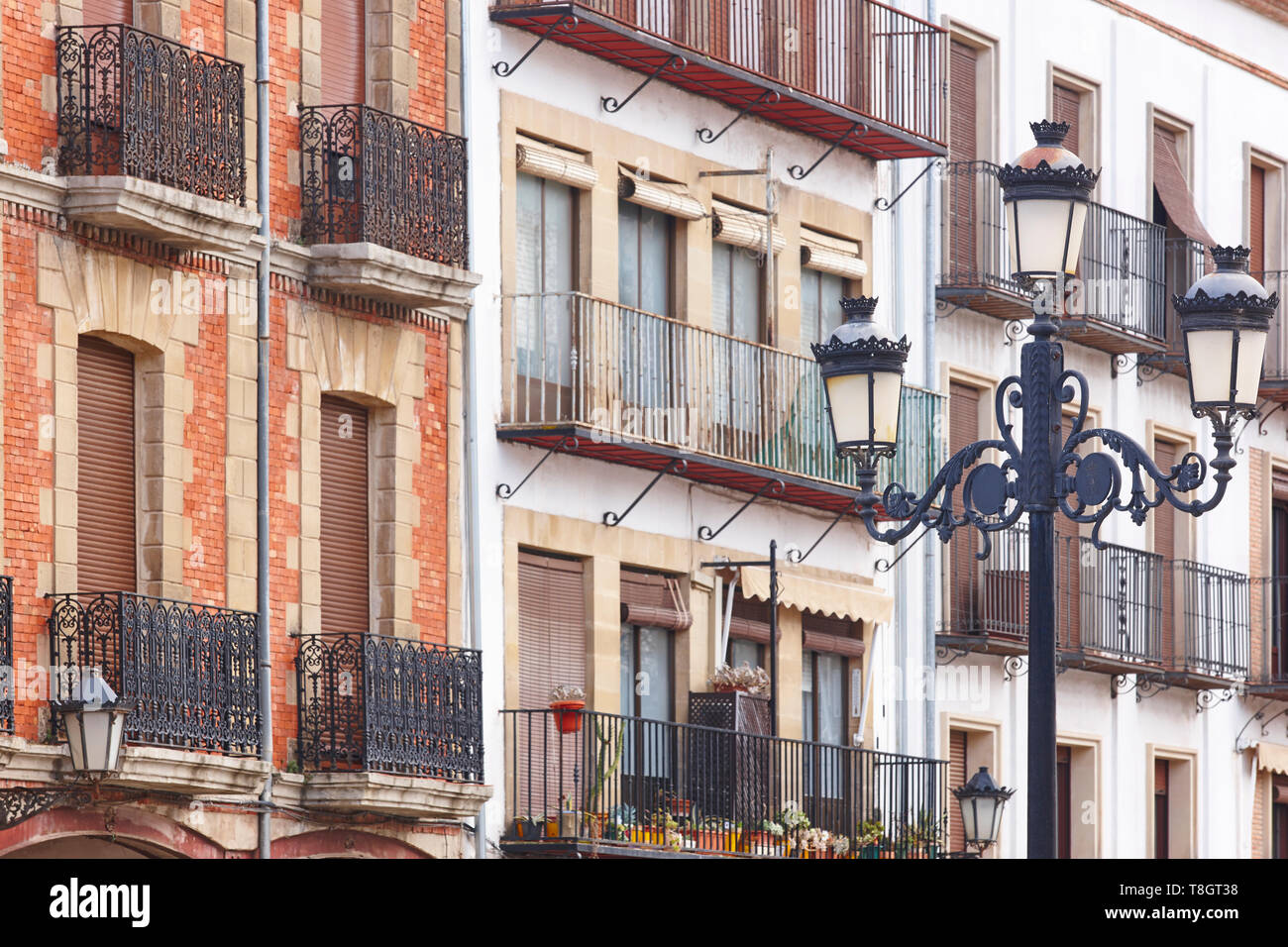 Traditional andalusian village facades and lamp in Baeza, Jaen. Spain - Stock Image