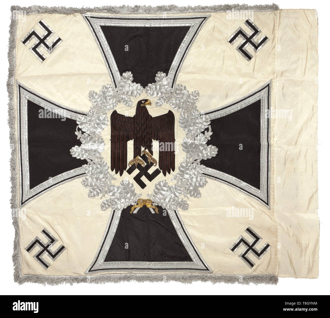 A troop flag of the infantry Made entirely of white silk with silver fringe on three sides. With a white disc on both sides, bordered by a silver embroidered oak leaf wreath with central brown army eagle, in the background an Iron Cross of black silk, bordered in silver. The corners with black swastikas, bordered in silver. Colour-fresh, the pole-sleeve with traces of nails, barely noticeable stains. Dimensions circa 120 x 120 cm. In family possessions since the end of the war. historic, historical, infantry, military, armed forces, militaria, ob, Additional-Rights-Clearance-Info-Not-Available Stock Photo