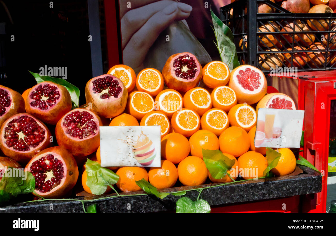 Istanbul, Turkey, March 08,2019: pile of raw oranges and pomegranates on street market, preparation of fresh juicy outdoor on sunny day, close up full - Stock Image