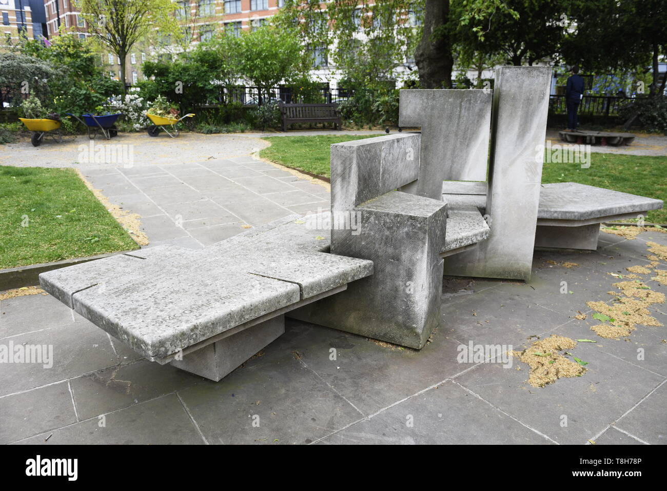 Sculptured stone bench 2006, designed by Sam Dawkins and Donna Walker. Located in Smithfield Rotunda Garden, West Smithfield, Farringdon, London EC1A  - Stock Image