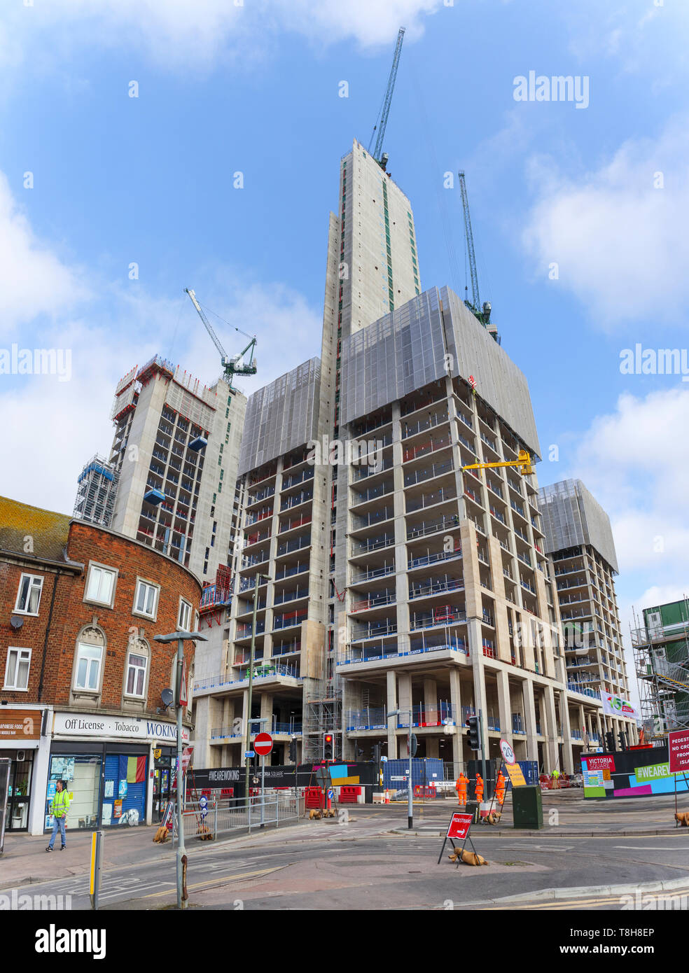 Woking, Surrey: construction of the new high rise mixed use Victoria Square development continues with concrete cores and tower cranes - Stock Image