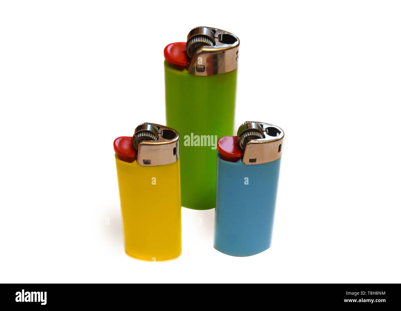 Three colorful lighters isolated on white background with copy space - Stock Image
