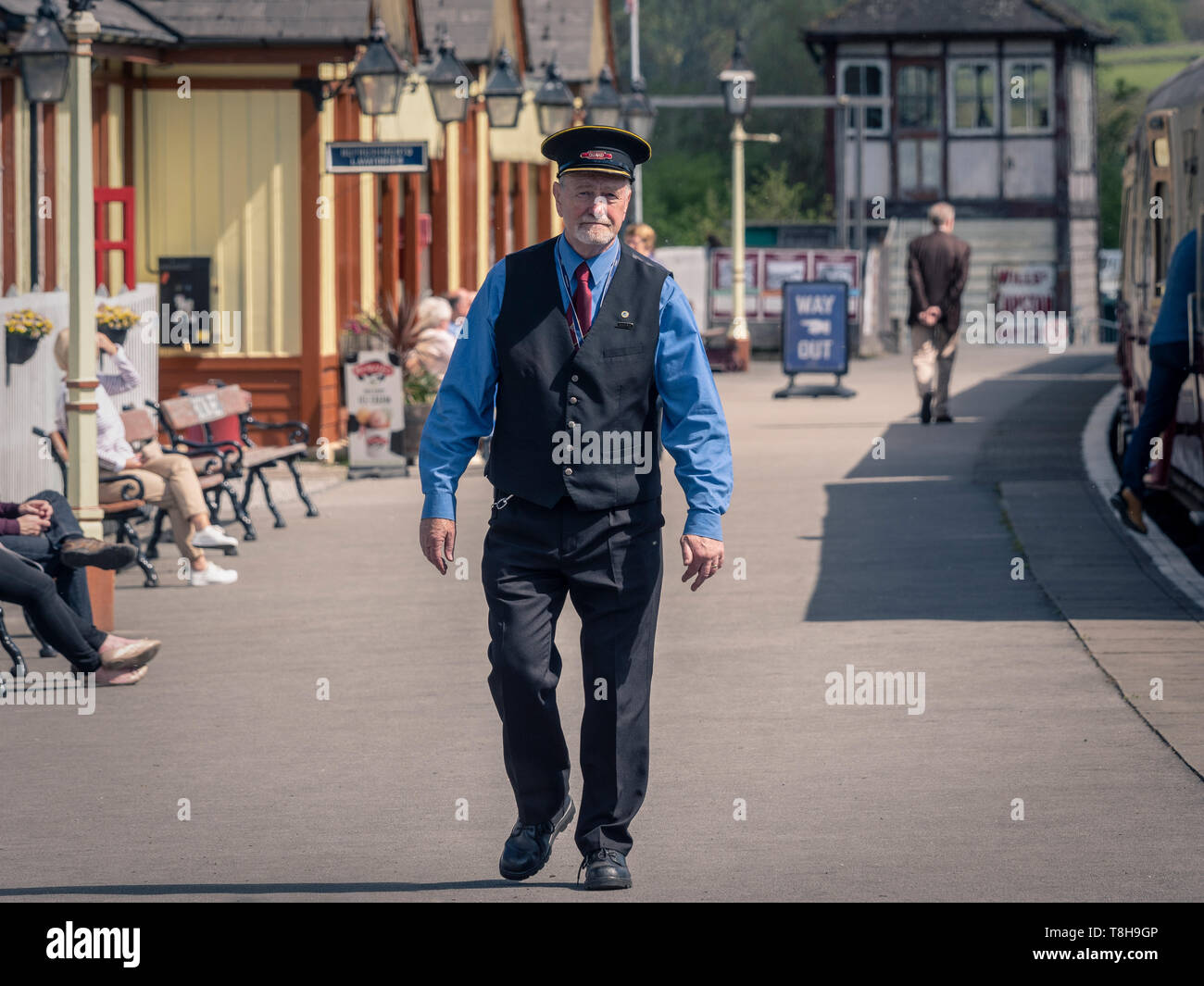 Guard on platform, Bolton and Embsay steam railway. Bolton Station, Yorkshire Dales, UK. - Stock Image