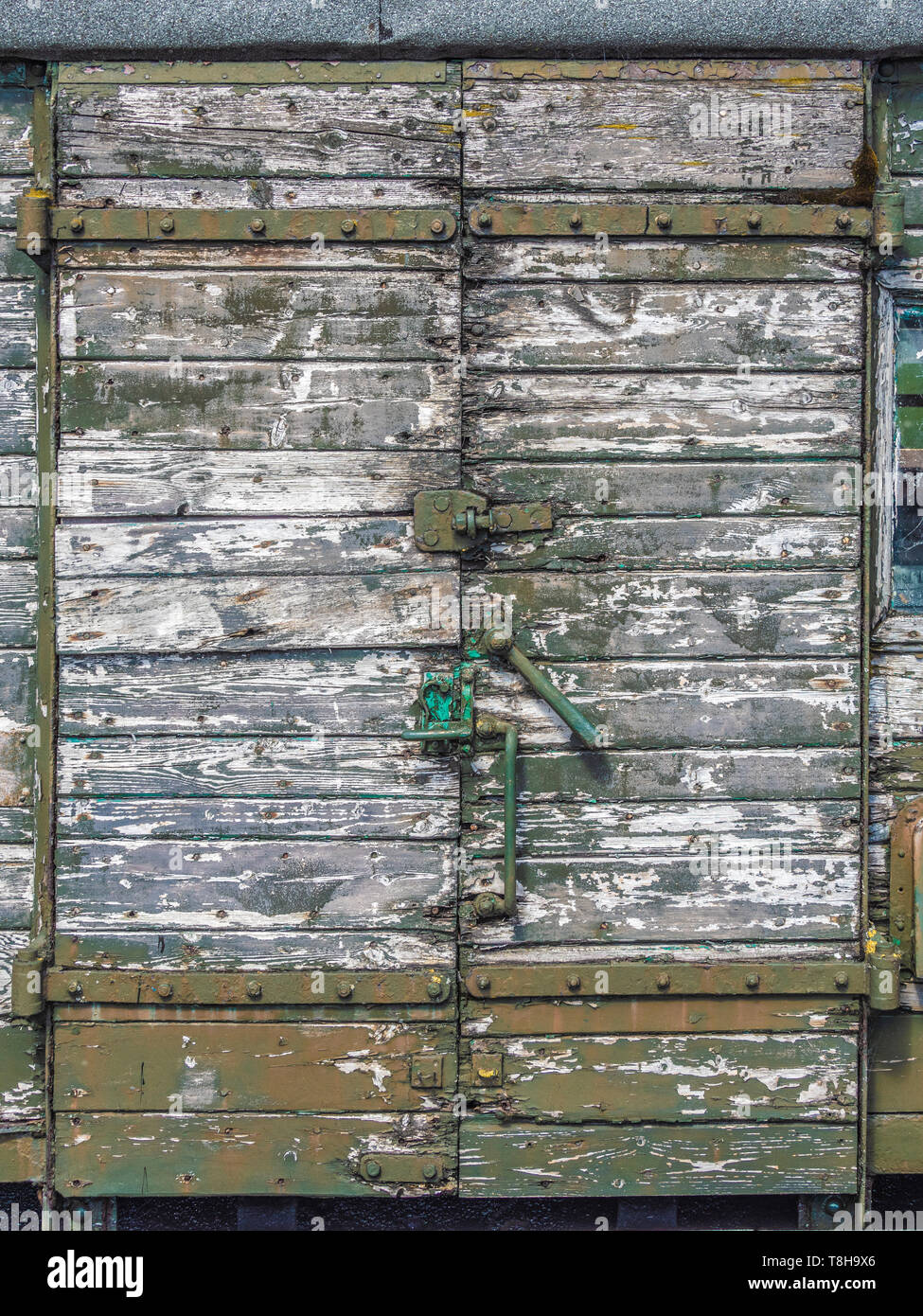 Decrepit wooden doors on carriage awaiting restoration at Bolton and Embsay steam railway. Bolton Station, Yorkshire Dales, UK. - Stock Image