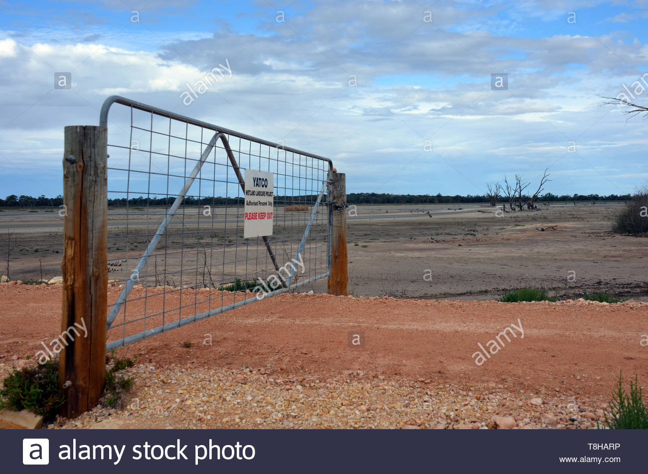 Yatco Wetlands 'keep out' gate on an angle with no fence. Moorook, South Australia. Dry wetlands. Colour photo. - Stock Image
