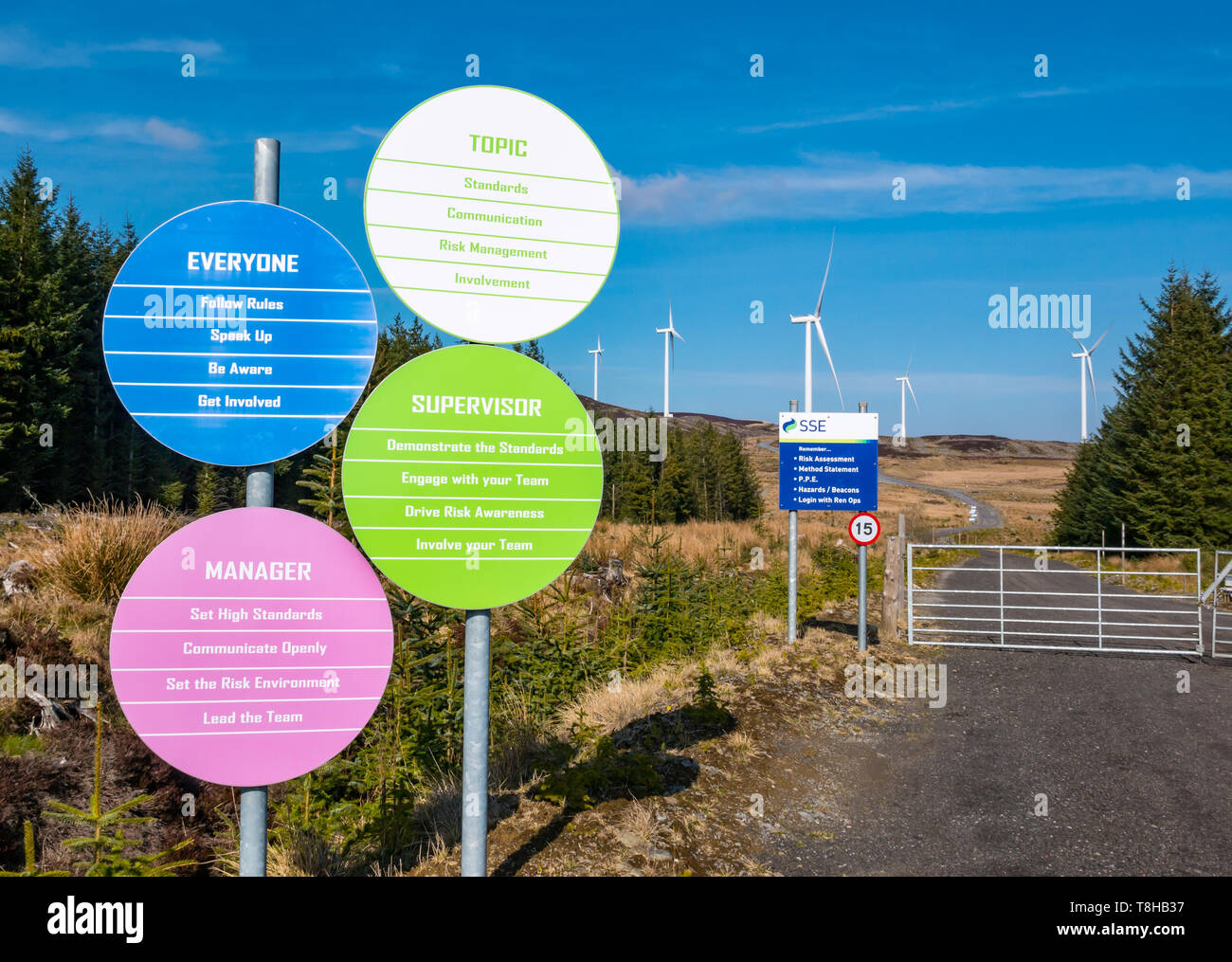 SSE company policy safety notices and wind turbines on hill at Griffin wind farm, Perthshire, Scotland, UK - Stock Image