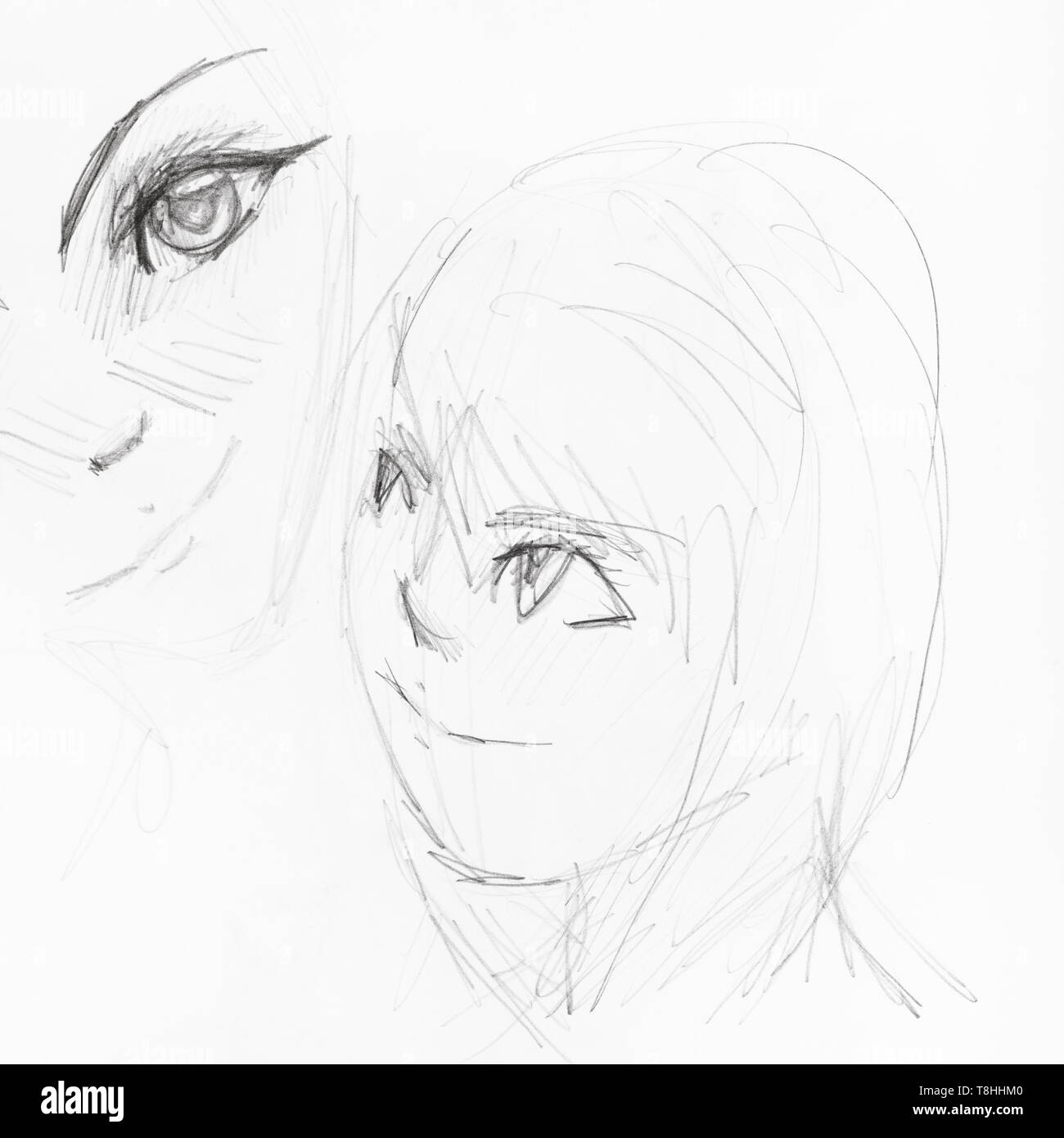 Sketches of girls faces in anime style hand drawn by black pencil on white paper