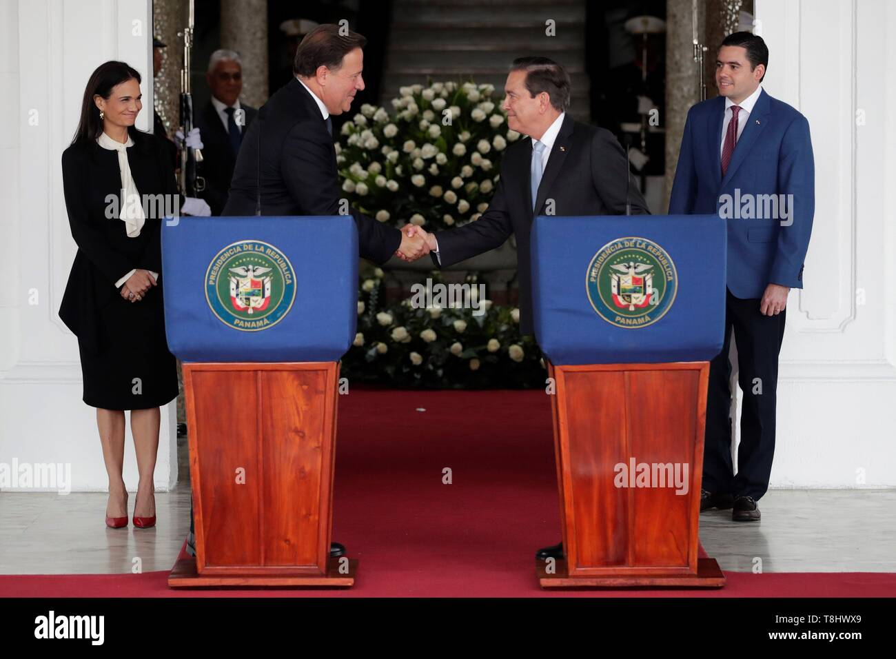 Panama's President Juan Carlos Varela (L) shakes hands with the elect President Laurentino Cortizo (R) after a meeting of command handover at the Presidential Palace, in Panama City, Panama, on 13 May 2019. EFE/Bienvenido Velasco Stock Photo