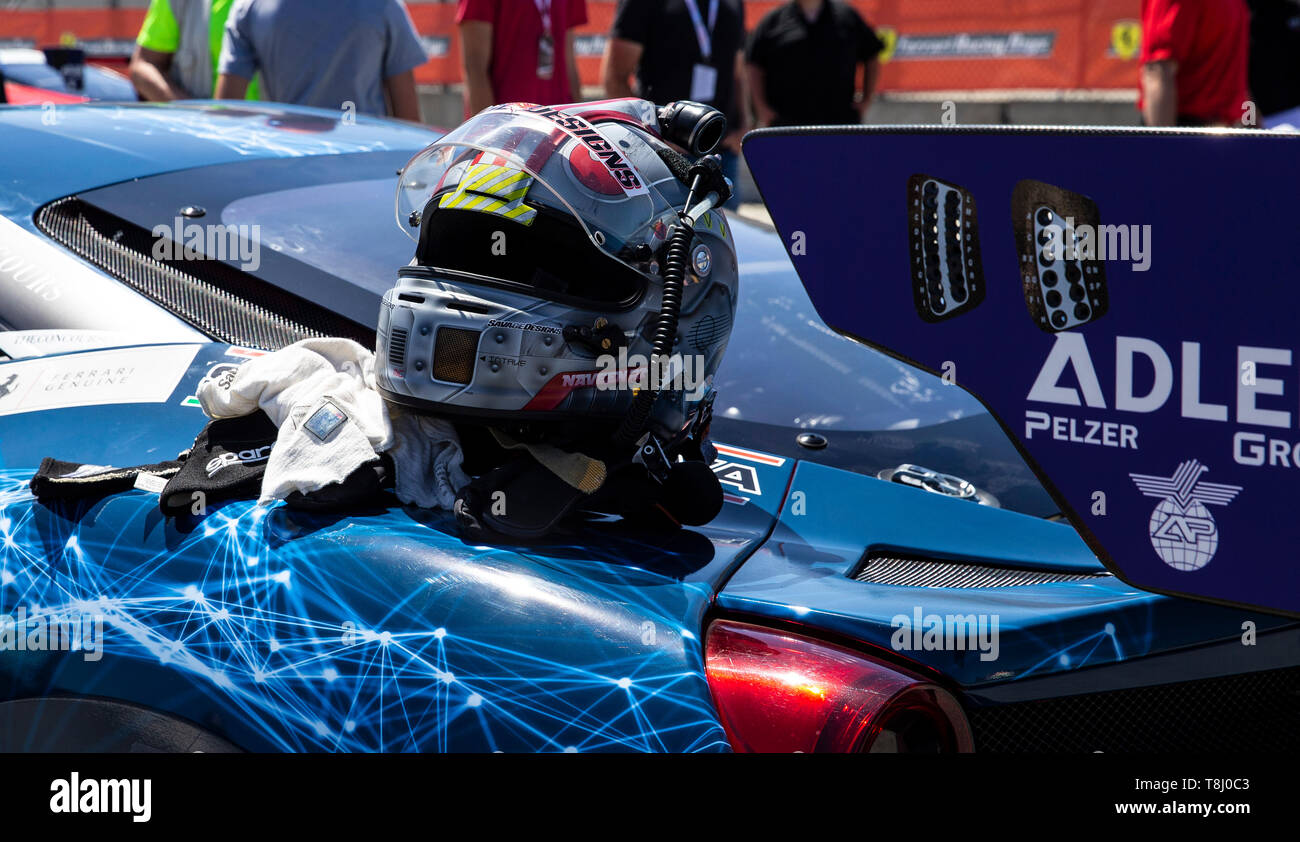May 11 2019 Monterey CA, U.S.A. # 64 Naveen Rao of Ferrari of San Diego helmet on the grid during the Ferrari Challenge Race 1 P/P- AM at Weathertech Raceway Laguna Seca Monterey CA Thurman James/CSM - Stock Image