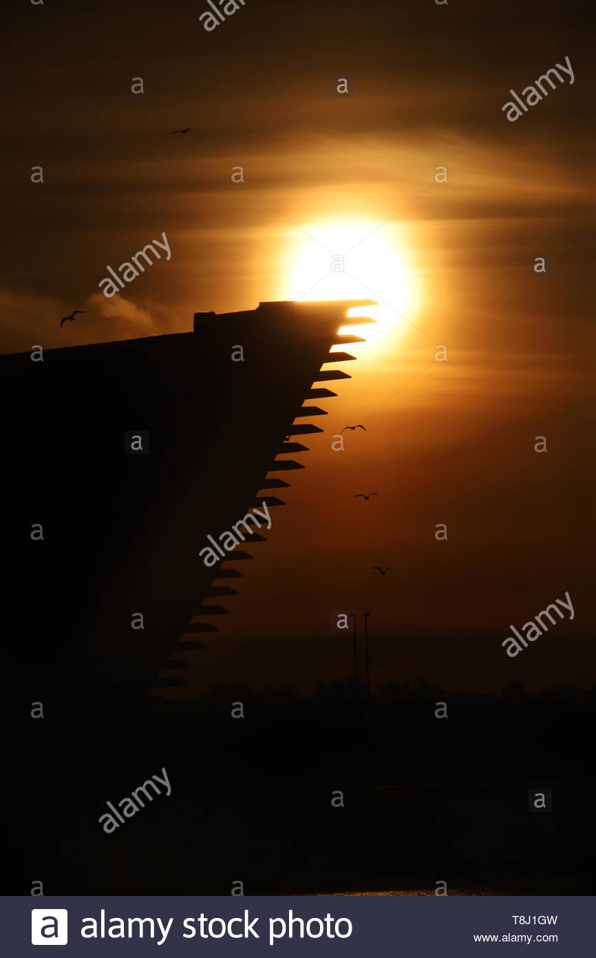 Dundee, UK. 14th May, 2019. The dramatic silhouette of the V&A Design Museum at sunrise in Dundee, a bright start to a warm sunny day in Tayside. Credit: Stephen Finn/Alamy Live News Stock Photo