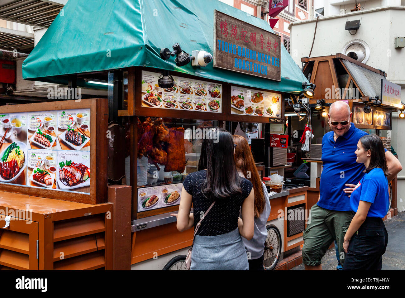 Tourists and Locals Queueing At A Food Stall, Chinatown, Singapore, South East Asia Stock Photo