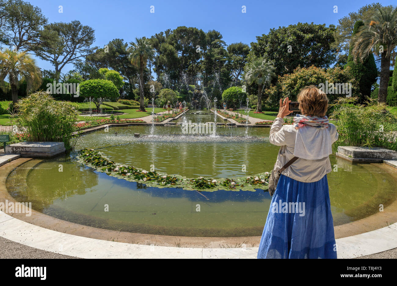 France, Alpes Maritimes, Saint Jean Cap Ferrat, villa and gardens Ephrussi de Rothschild, the French garden, large pond and water jets // France, Alpe - Stock Image