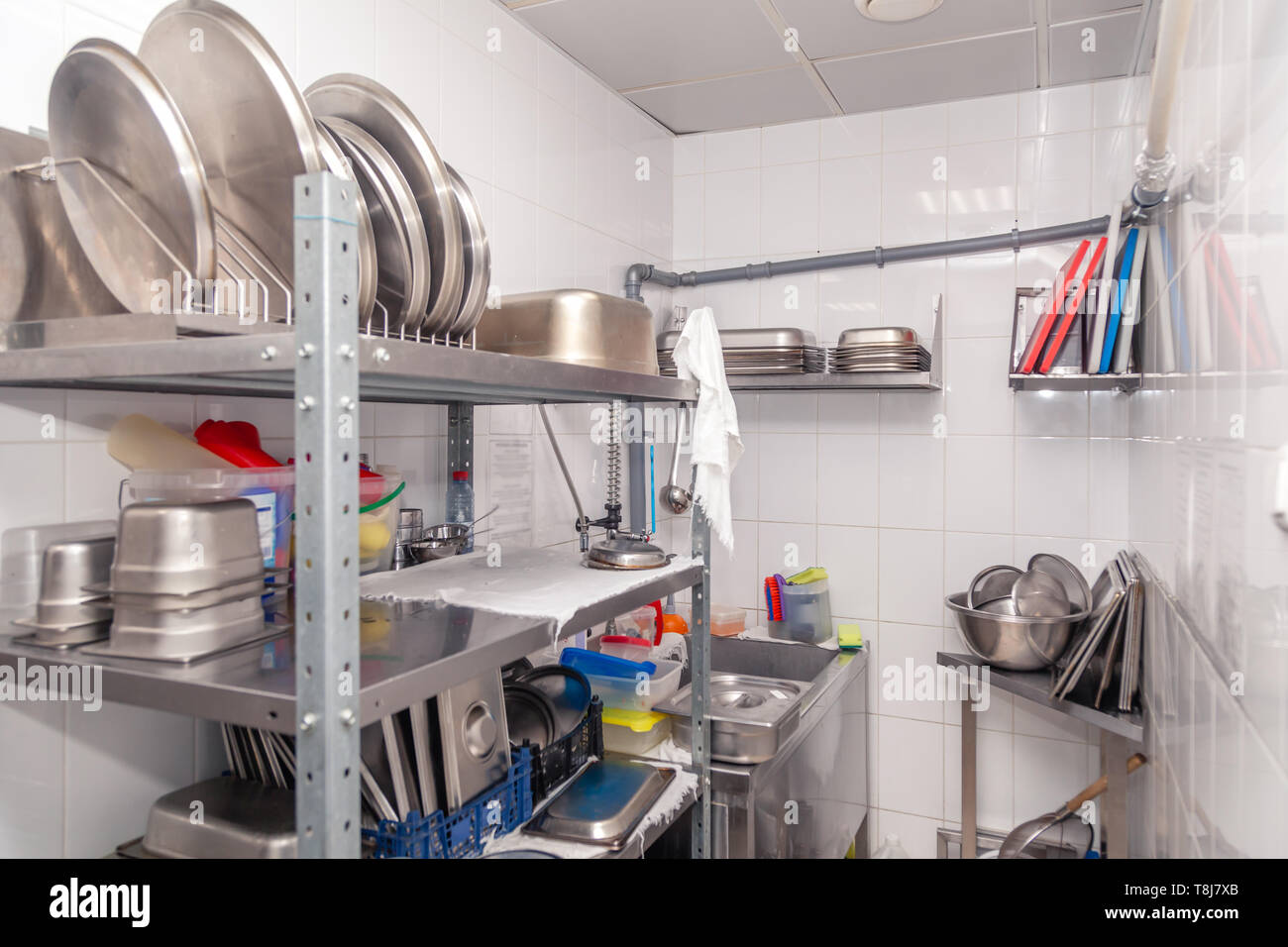View of restaurant\'s professional washer, sink, brushes ...