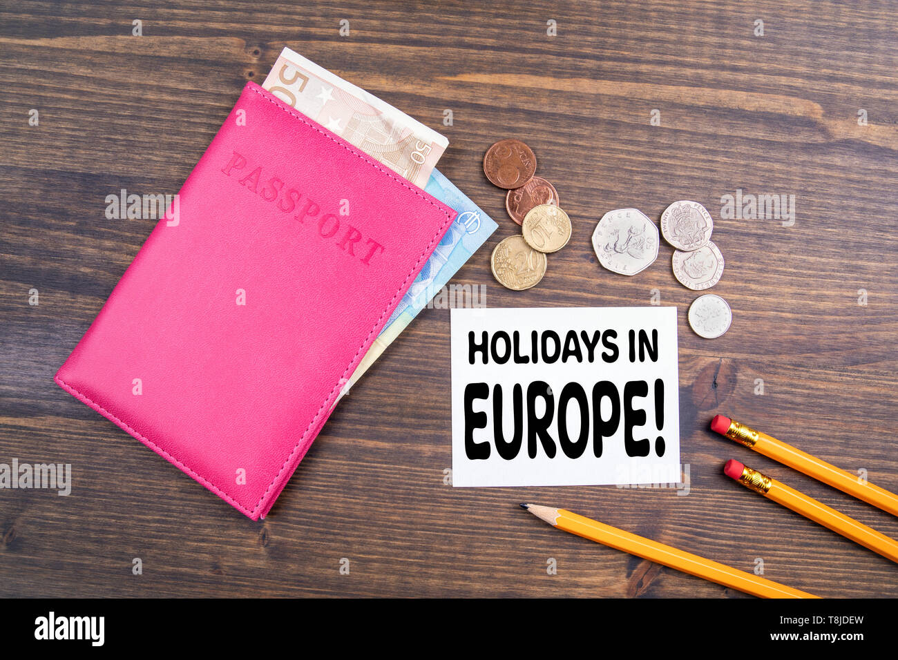 Holidays in Europe. Euro money and British coins with passport - Stock Image