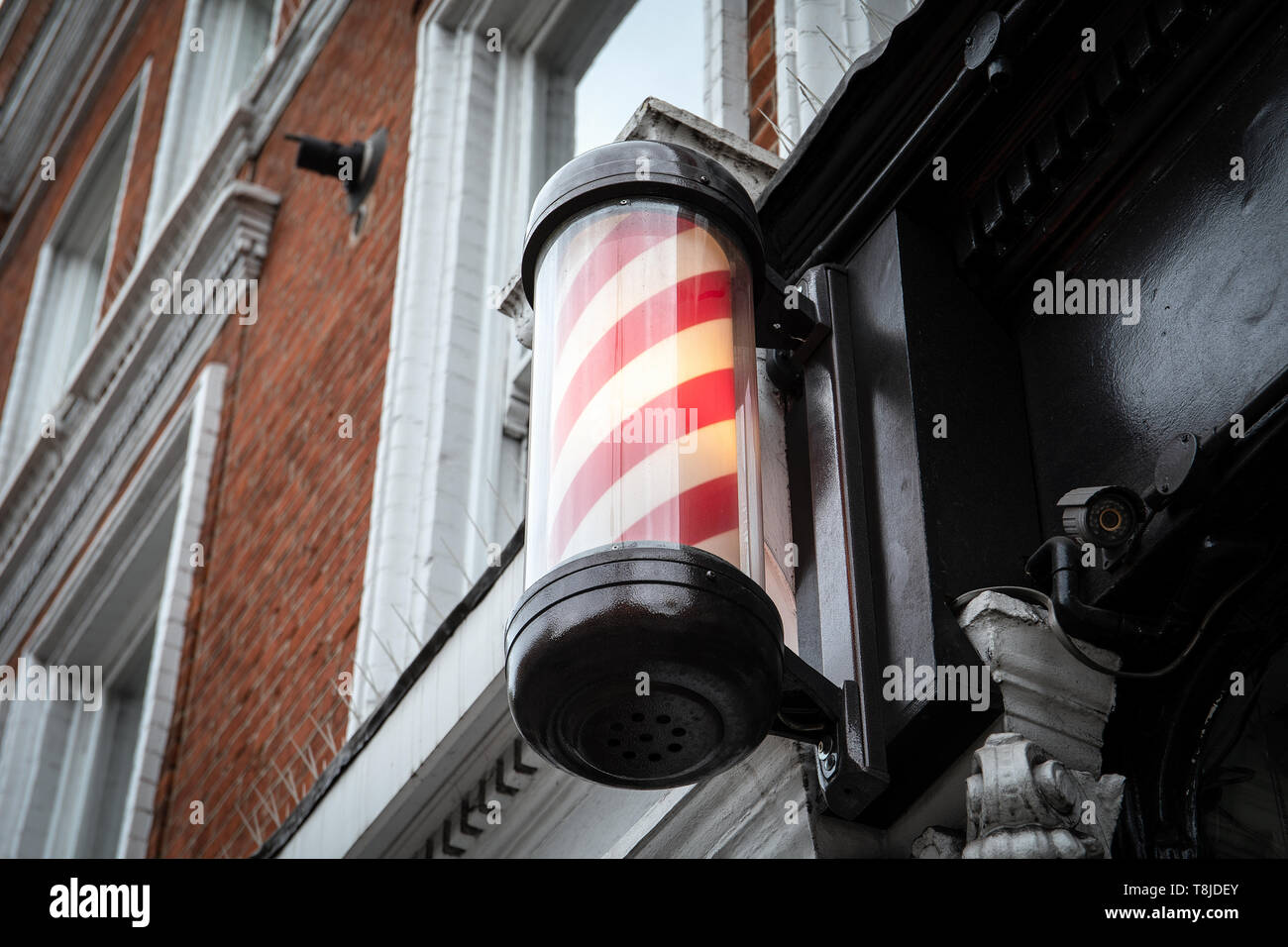 A barber's pole - sign used by barbers - Stock Image