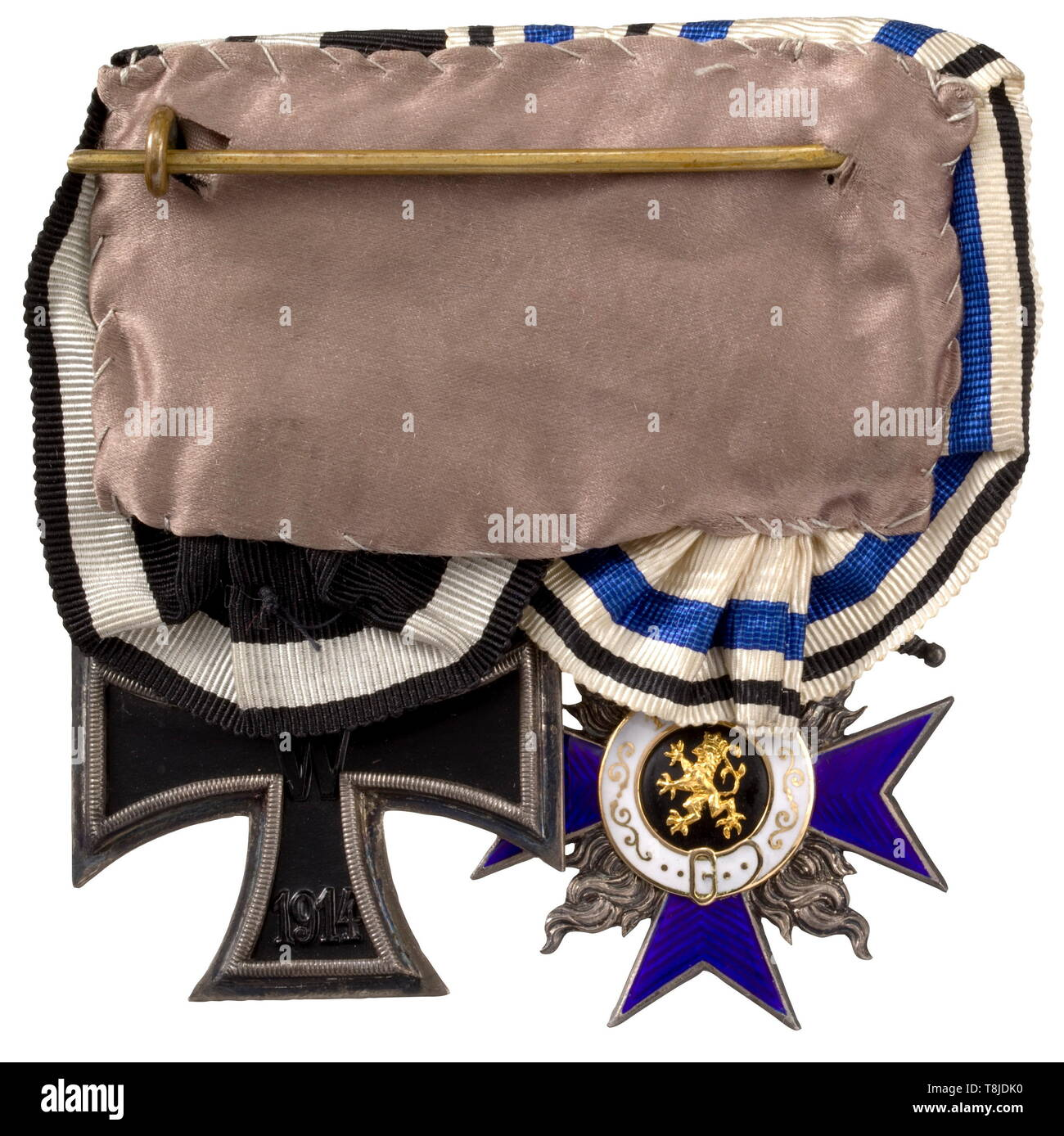 A two-piece orders clasp of an officer in the World War Military Merit Order 4th Class with Crown and Swords in the early (pre-July 1916) World War issue of the Jacob Leser firm in Straubing. The three-section medallion in pure gold, the back of the agraffe with corresponding punch marks. Together with an Iron Cross 2nd Class of 1914 with the early award presentation case with gold-embossed signet of Court Art Institute Leser and an enclosed section of ribbon. The MVO is undamaged, rare in this condition. historic, historical, medal, decoration, , Additional-Rights-Clearance-Info-Not-Available Stock Photo