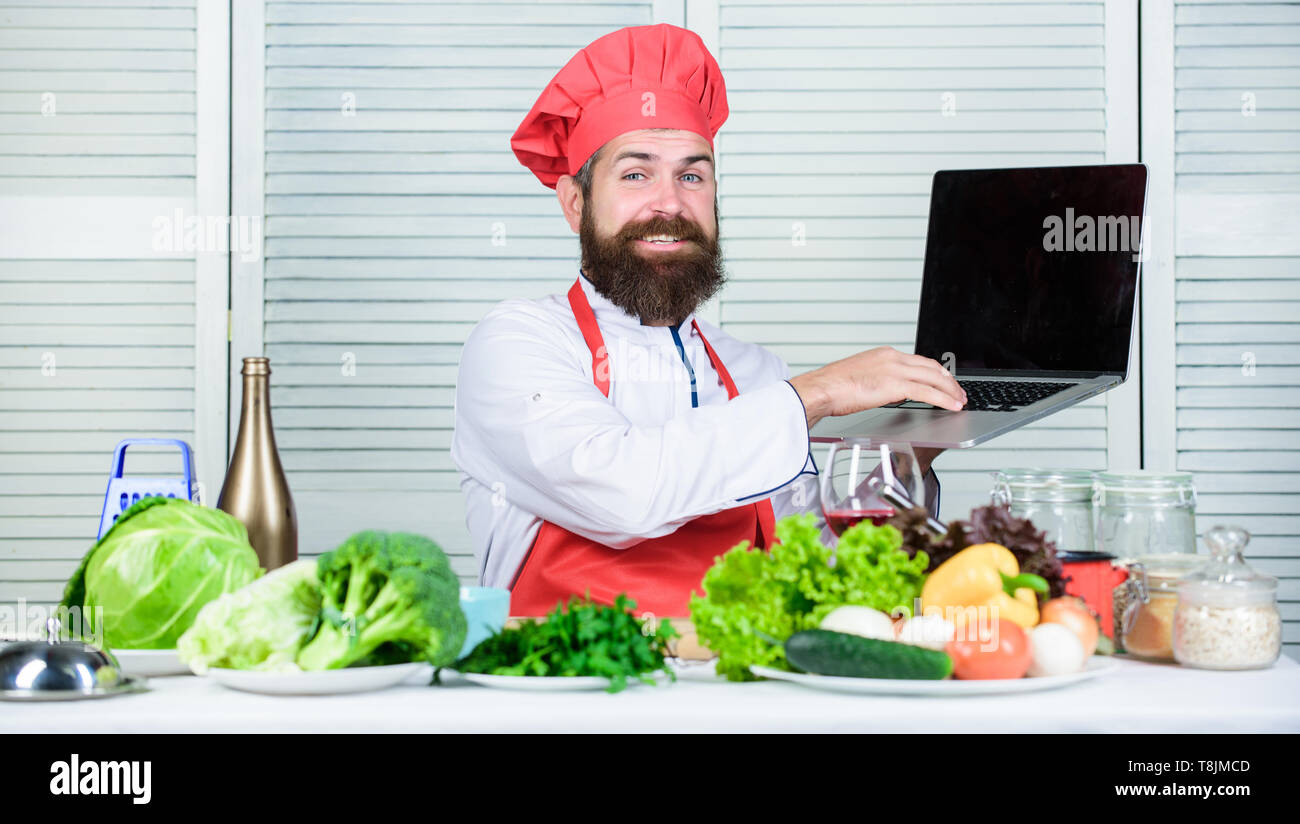 TV show. Happy bearded man. chef recipe. Vegetarian salad with fresh vegetables. Dieting organic food. Cuisine culinary. Vitamin. Healthy food cooking. Mature hipster with beard. - Stock Image