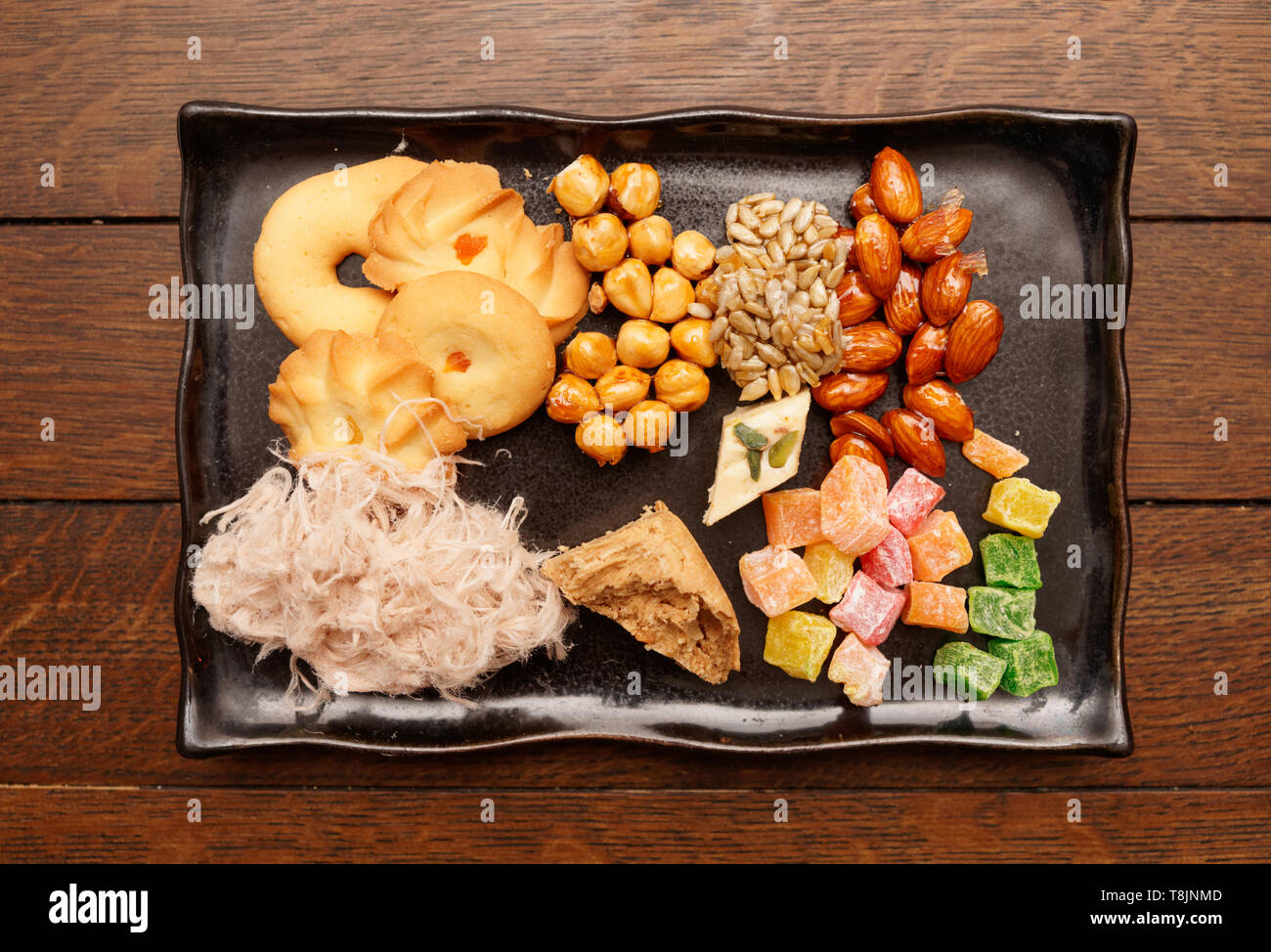 Oriental sweets on plate shot from above - Stock Image