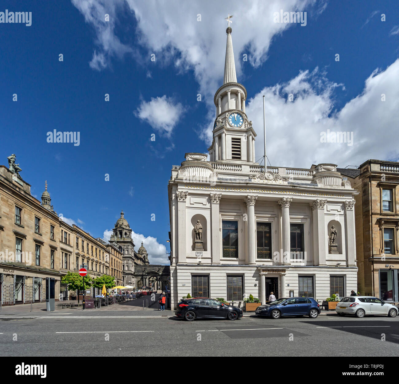 The Italian Centre with food outlets in John Street left & Hutcheson former hospital with Hutchesons City Grill in Ingram Street Glasgow Scotland UK - Stock Image