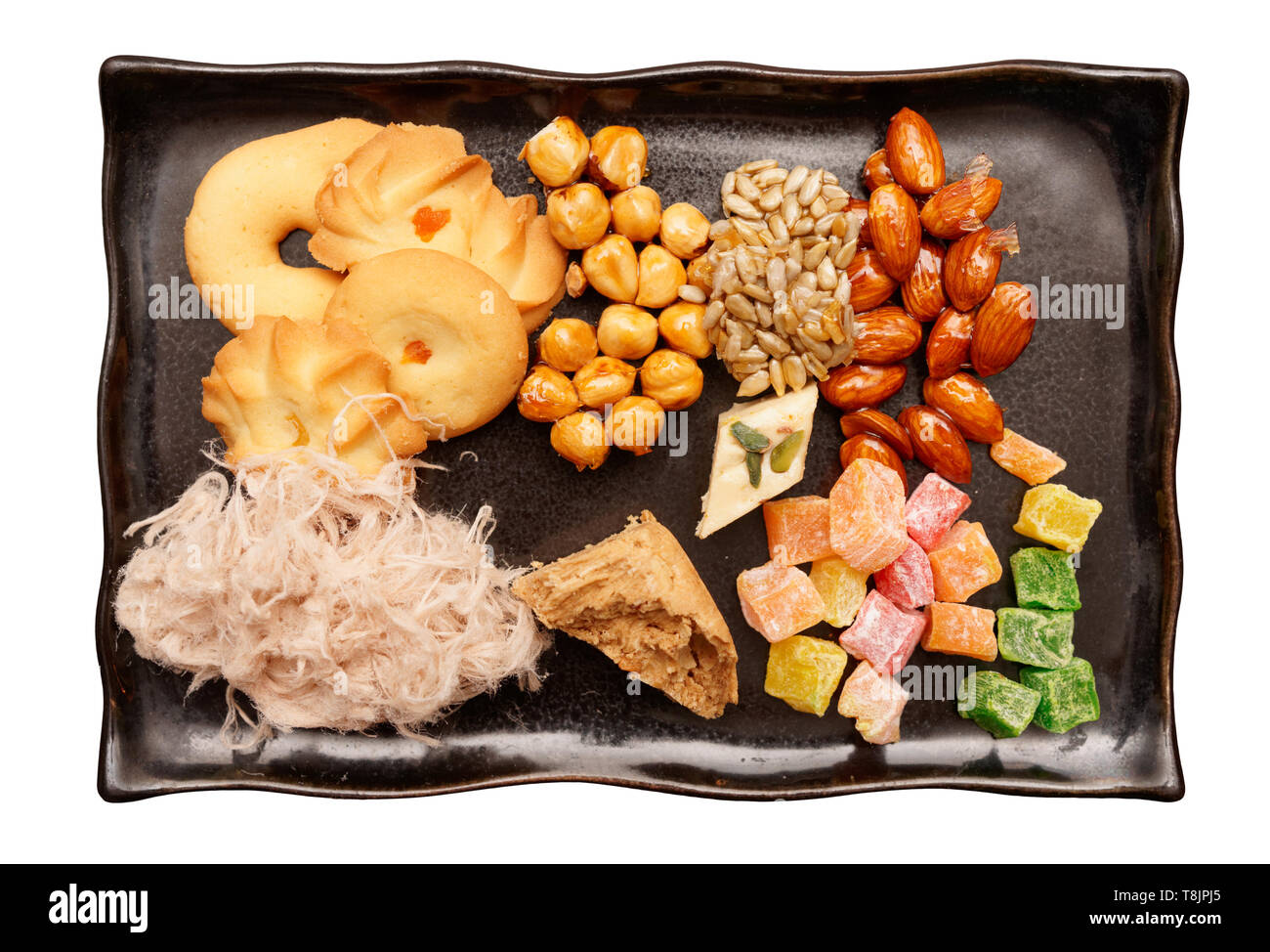 Oriental sweets on plate shot from above isolated with clipping path - Stock Image
