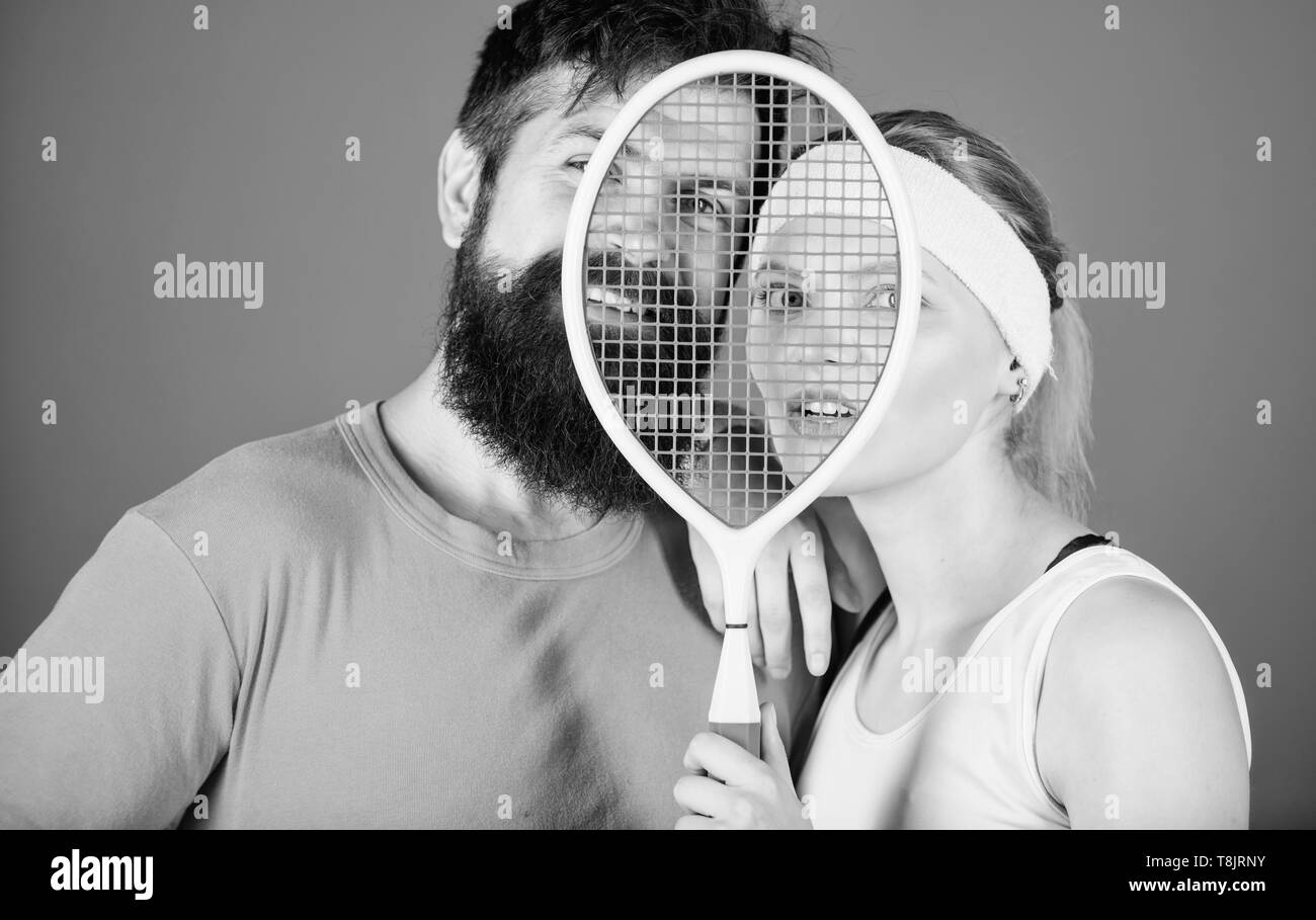 This game is more than hobby. Healthy lifestyle concept. Man and woman couple in love with tennis racket sport equipment. Workout and fitness. Girl and guy play tennis. Couple tennis players. - Stock Image