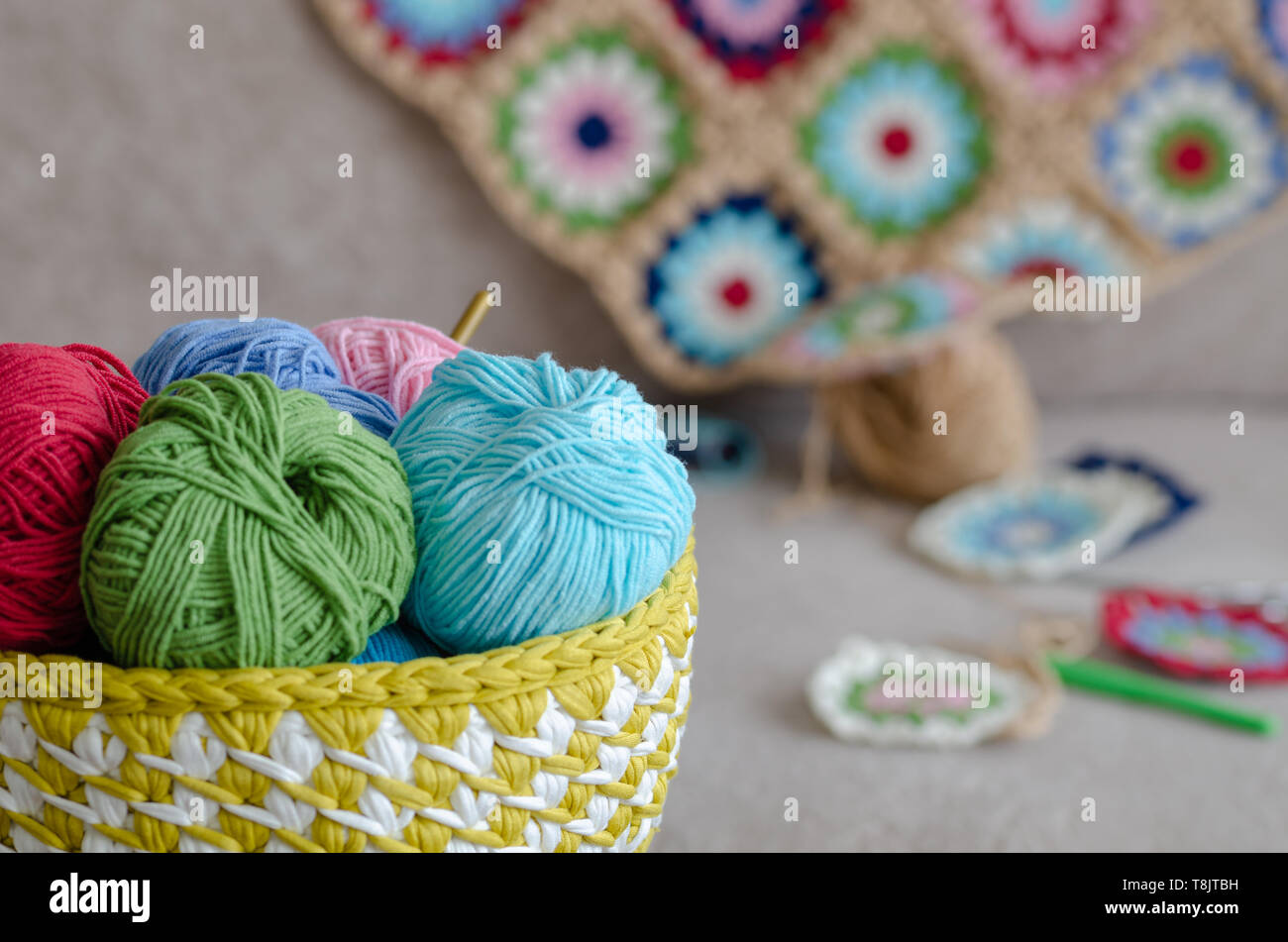 Multi Colored Baby Blanket And Colorful Yarns On Sofa Green Pink Cream Blue Red Color Yarns Scissors Are On The Sofa Stock Photo Alamy