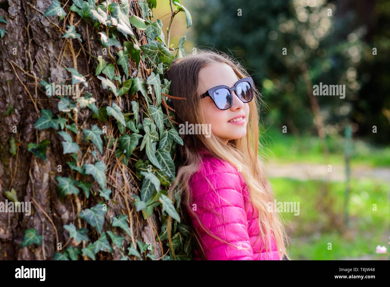 Pleasant relaxing walk in garden. Peaceful environment garden. Girl walk in botanical garden. Enjoying nature in garden. Kid cute fancy child spend time in park. Plants grown for display to public. - Stock Image