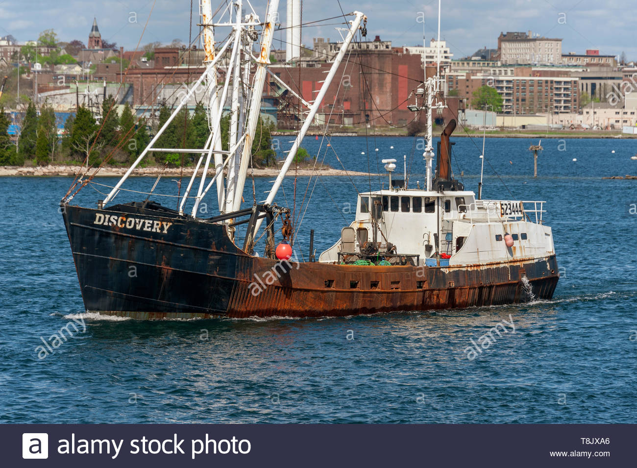 New Bedford, Massachusetts, USA - May 8, 2019: Eastern-rigged commercial fishing vessel Discovery heading out to sea - Stock Image