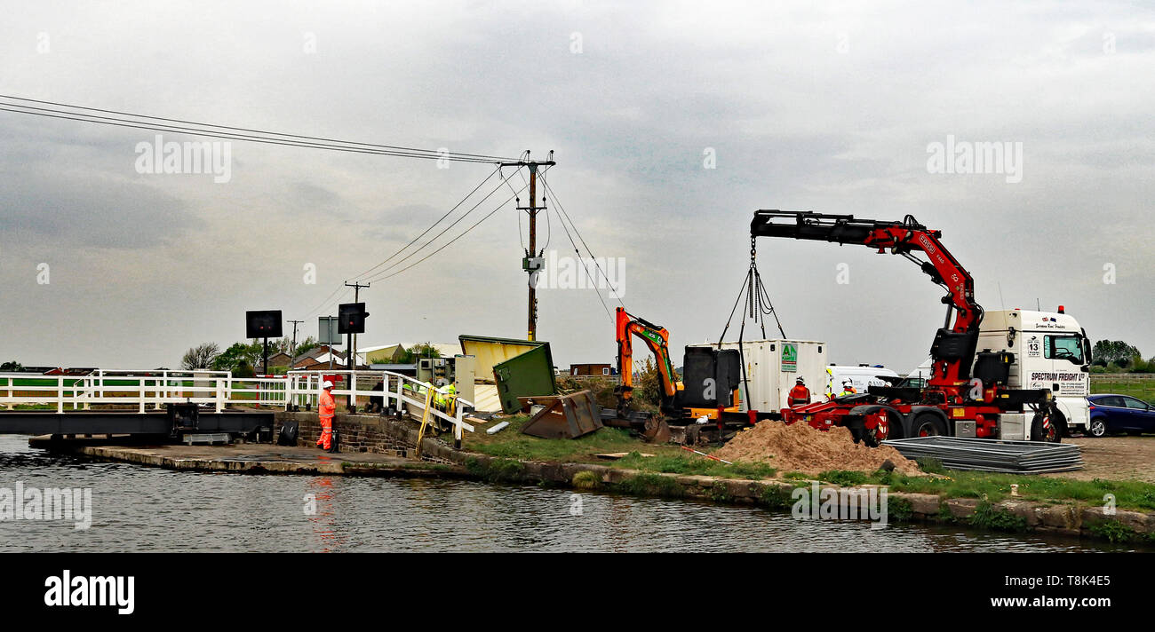 Engineers are working on removing the wrecked control's and operating equipment at Coxheads swing bridge  following a act of vandalism with a JCB. - Stock Image