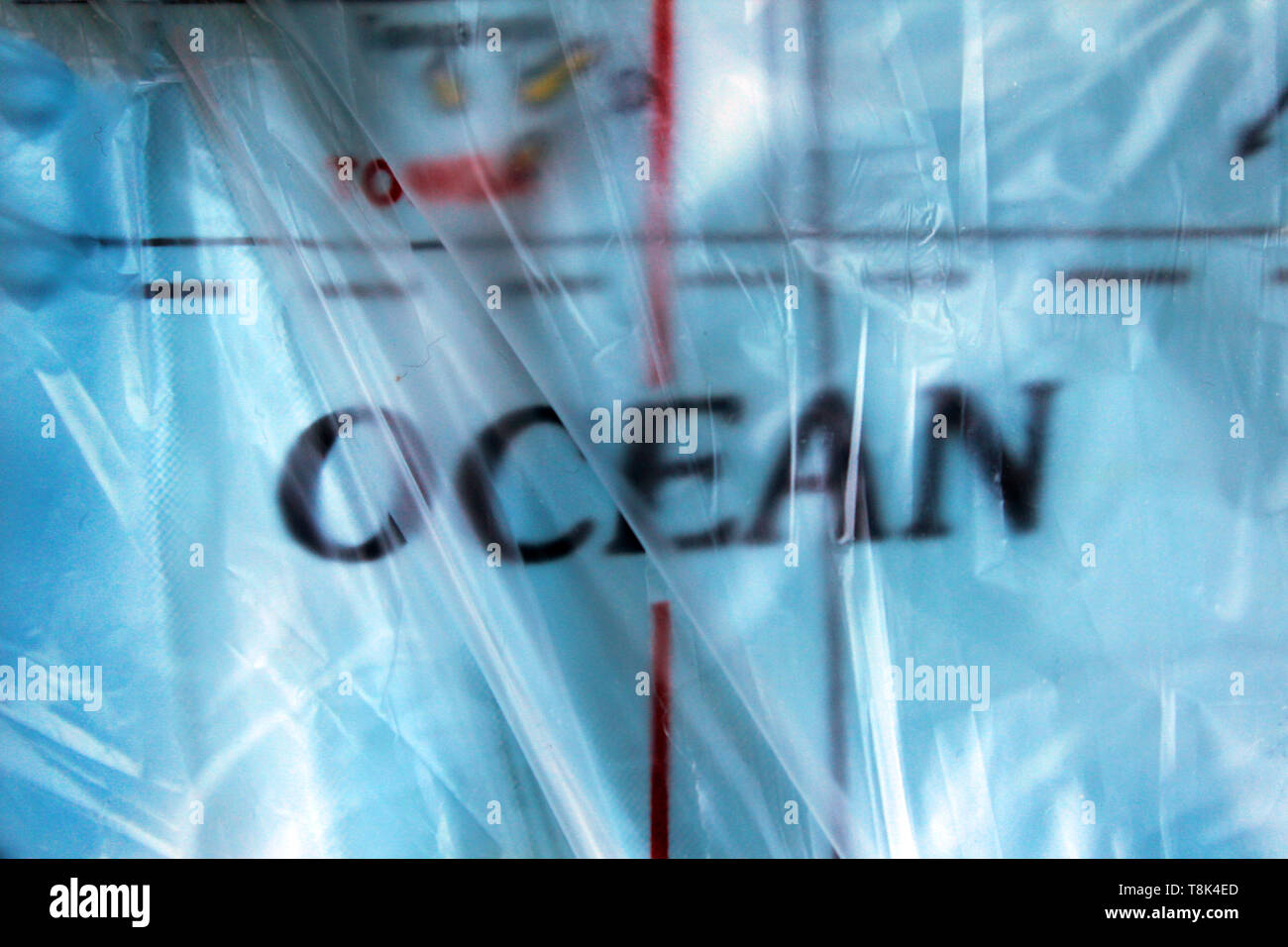 Ocean word, printed inside a plastic bag, concept, close-up - Stock Image