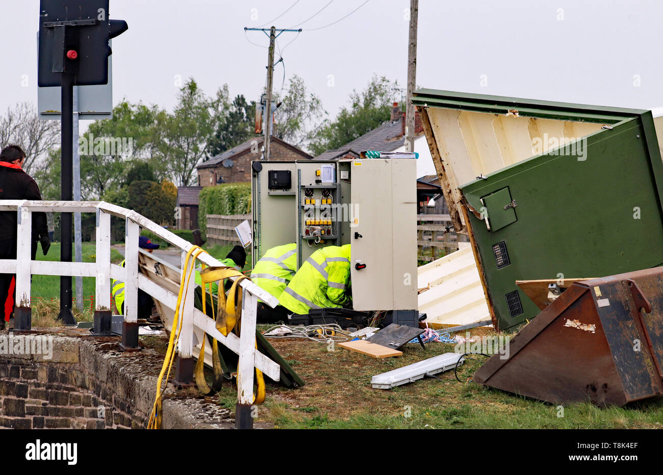 Engineers are working on removing the wrecked control electronics for Coxheads swing bridge  following a act of vandalism with a JCB Cw 6703 - Stock Image